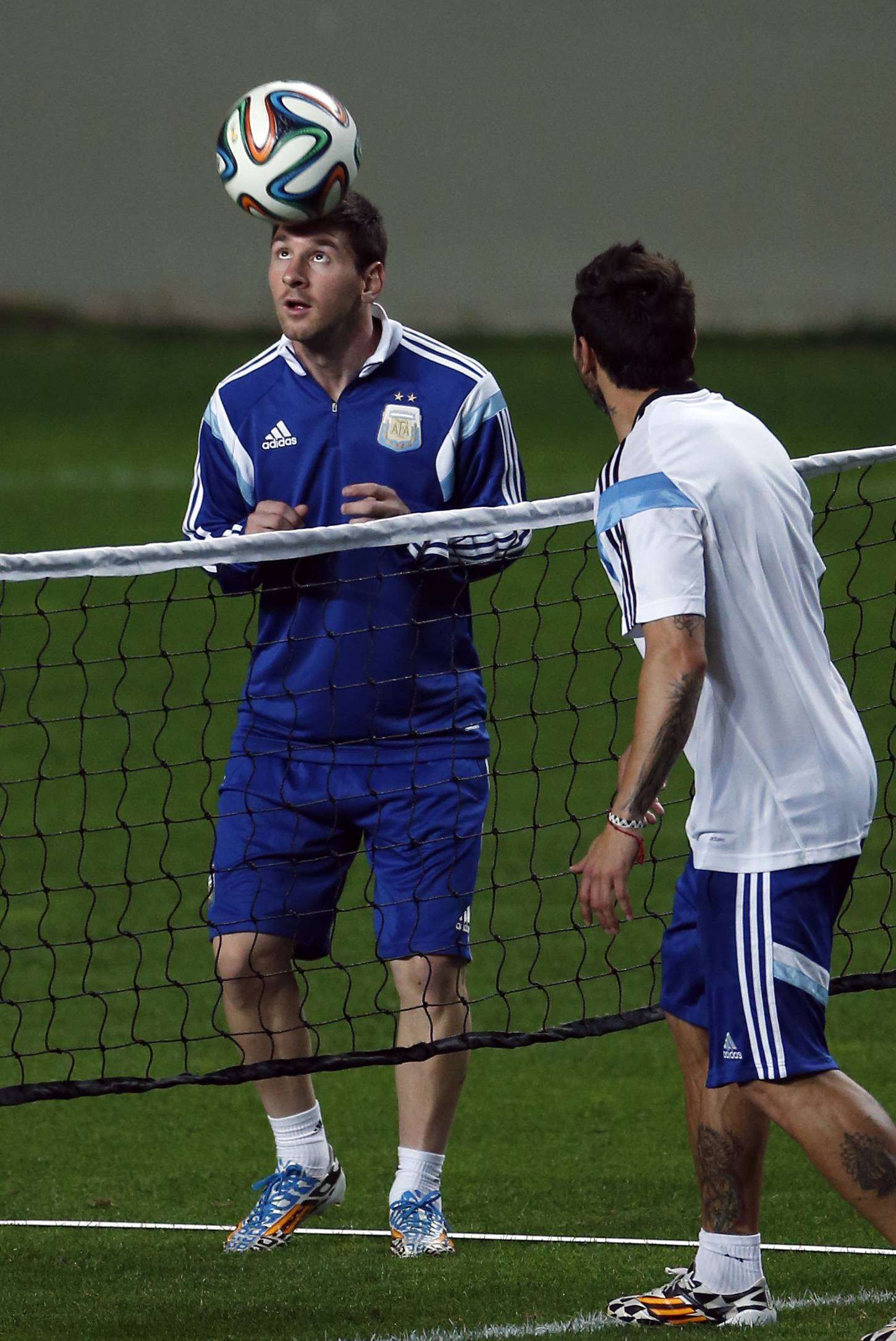 Argentina's Lionel Messi heads the ball, left, next to Argentina's Ezequiel Lavezzi, right, during a training session Wednesday at Independencia Stadium in Belo Horizonte, Brazil. Argentina will play in group F of the Brazil 2014 soccer World Cup.