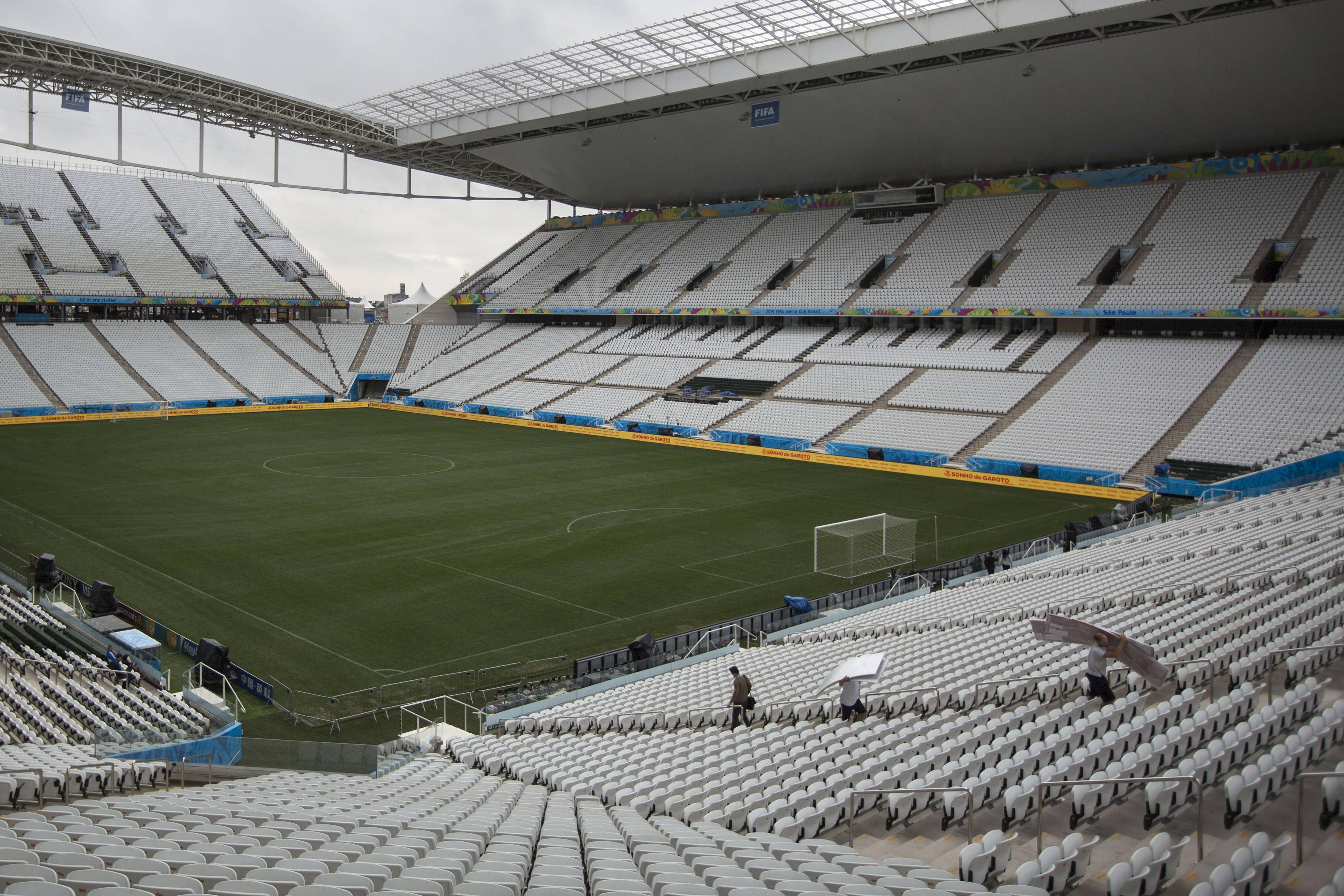 Final preparations are made one day before the opening World Cup soccer match in Itaquerao Stadium in Sao Paulo, Brazil, Wednesday, June 11, 2014. If Brazil wins the opening game, the fact that Itaquerao stadium isn't even fully finished yet will quickly be forgotten.