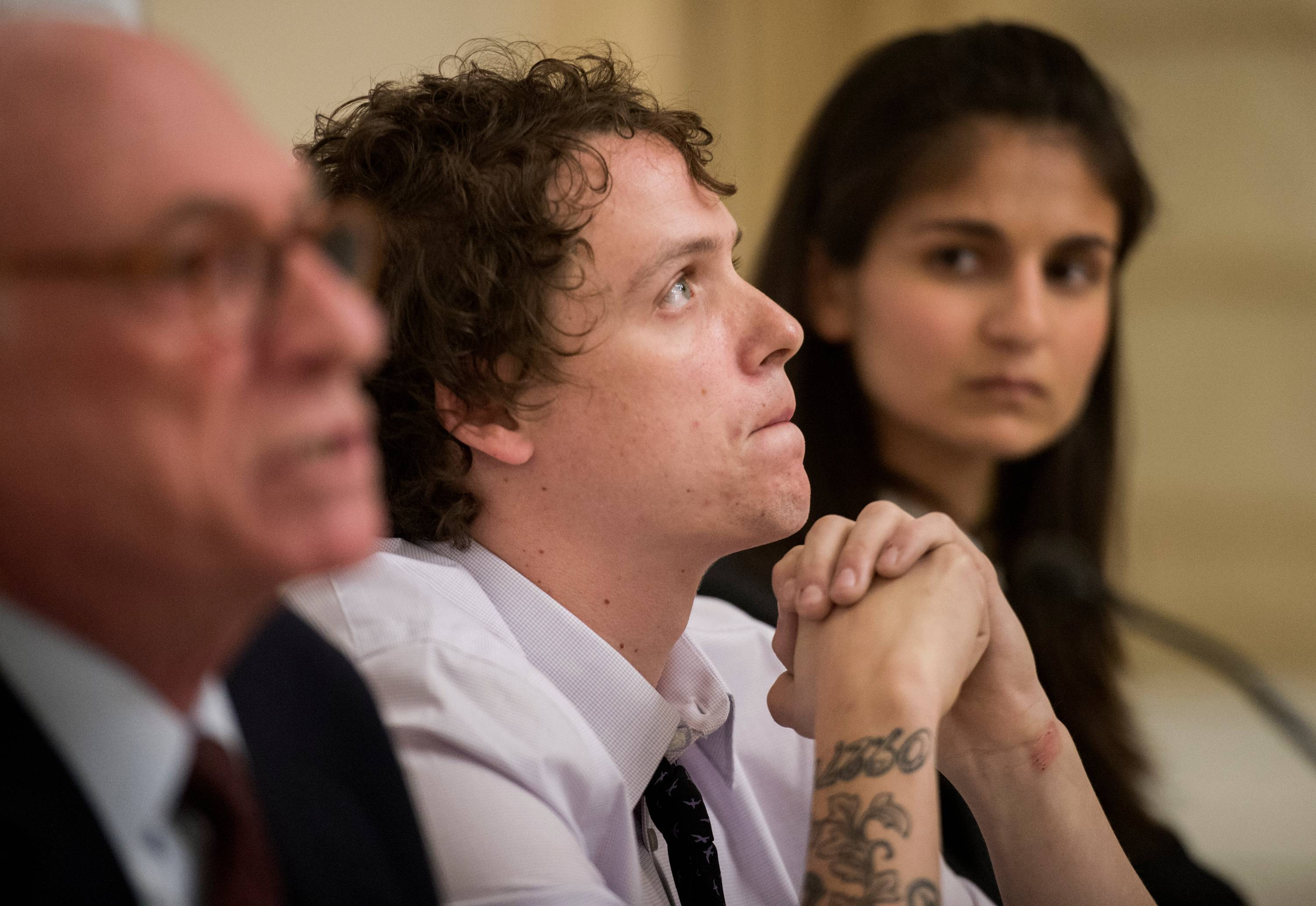 Jon Daniel, 29, of Peoria makes a statement as the American Civil Liberties Union's Harvey Grossman, left, and Roshni Shikari listen Thursday. The ACLU has filed a lawsuit on Daniel's behalf against Peoria's mayor and police chief.