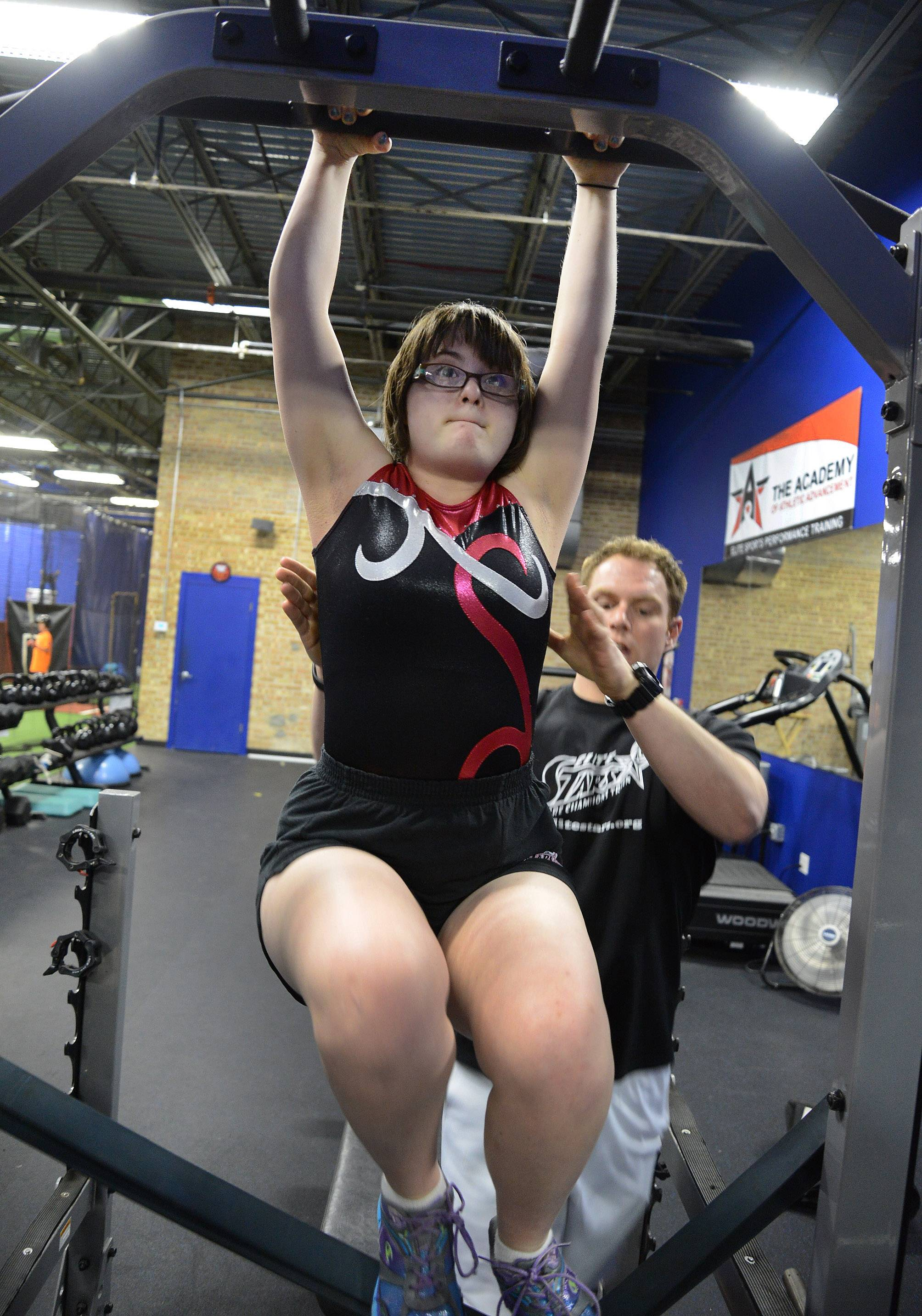 Karlee Darow of Palatine puts in some final practice this week with her trainer, Jason Domnanovich, before heading to New Jersey for the Special Olympics 2014 USA Games. Karlee, who has participated in gymnastics for a decade, has big goals for the national games.