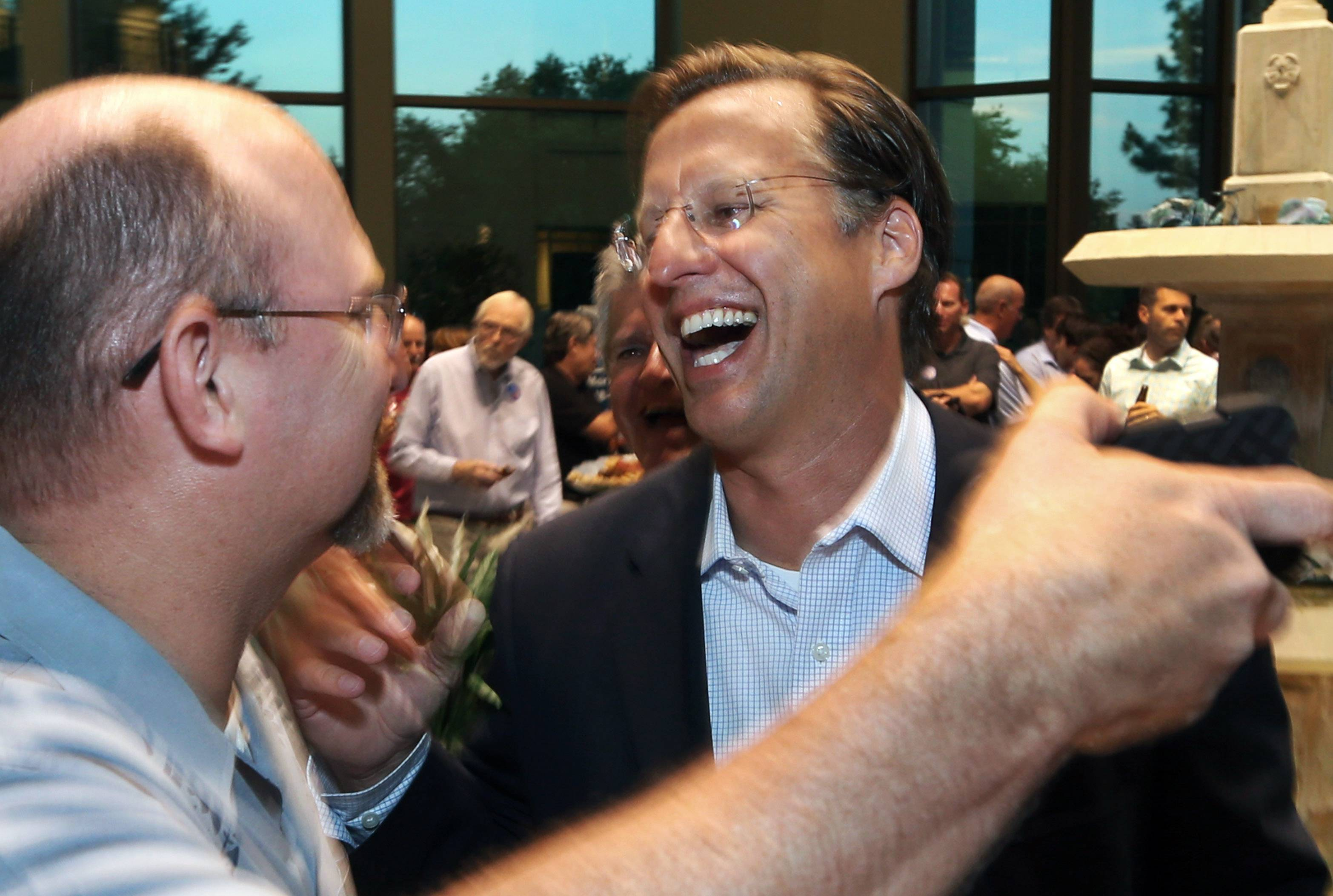 Dave Brat, right, is congratulated by Johnny Wetlaufer after Brat defeated House Majority Leader Eric Cantor in the Republican primary, Tuesday, June 10, 2014, in Richmond, Va. (AP Photo/Richmond Times-Dispatch, P. Kevin Morley)