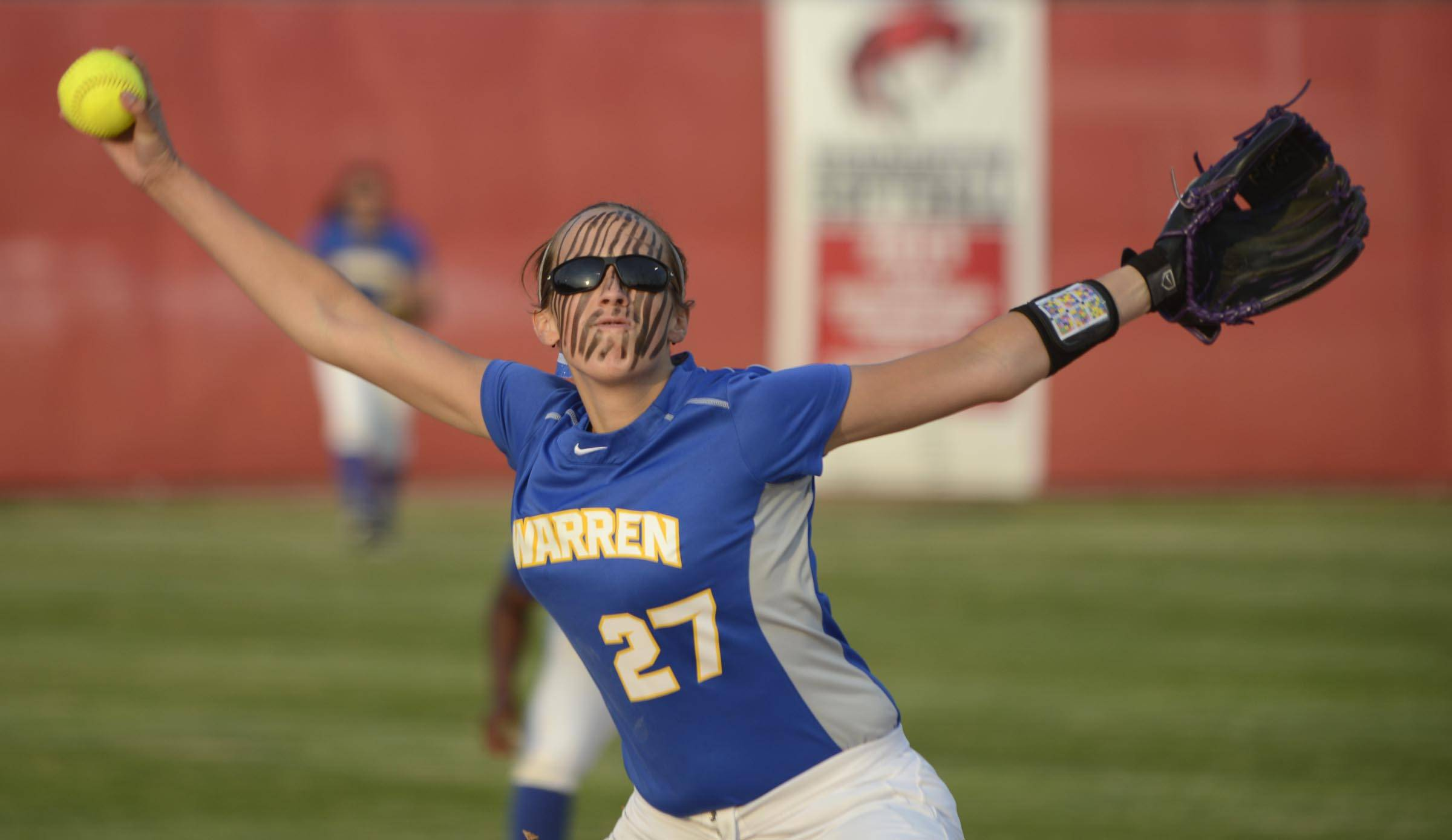 Warren's Jana Wagner delivers to the plate against Barrington in the Class 4A Barrington supersectional Monday.