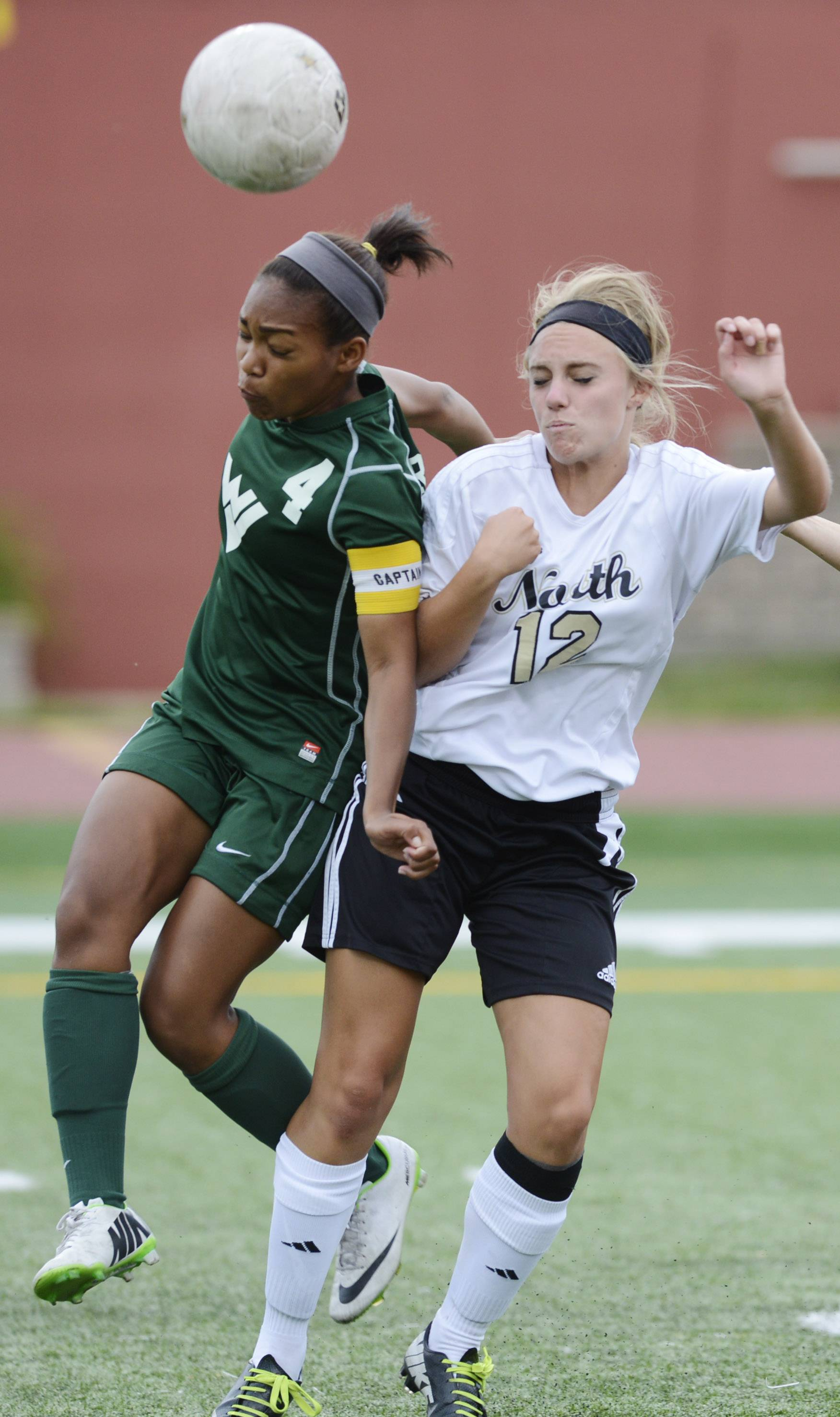Kristen Dodson, left, of Waubonsie Valley, left, gets in front of Lexi Cesario of Lincoln-Way North during the girls soccer Class 3A state third-place game at North Central College in Naperville Saturday.