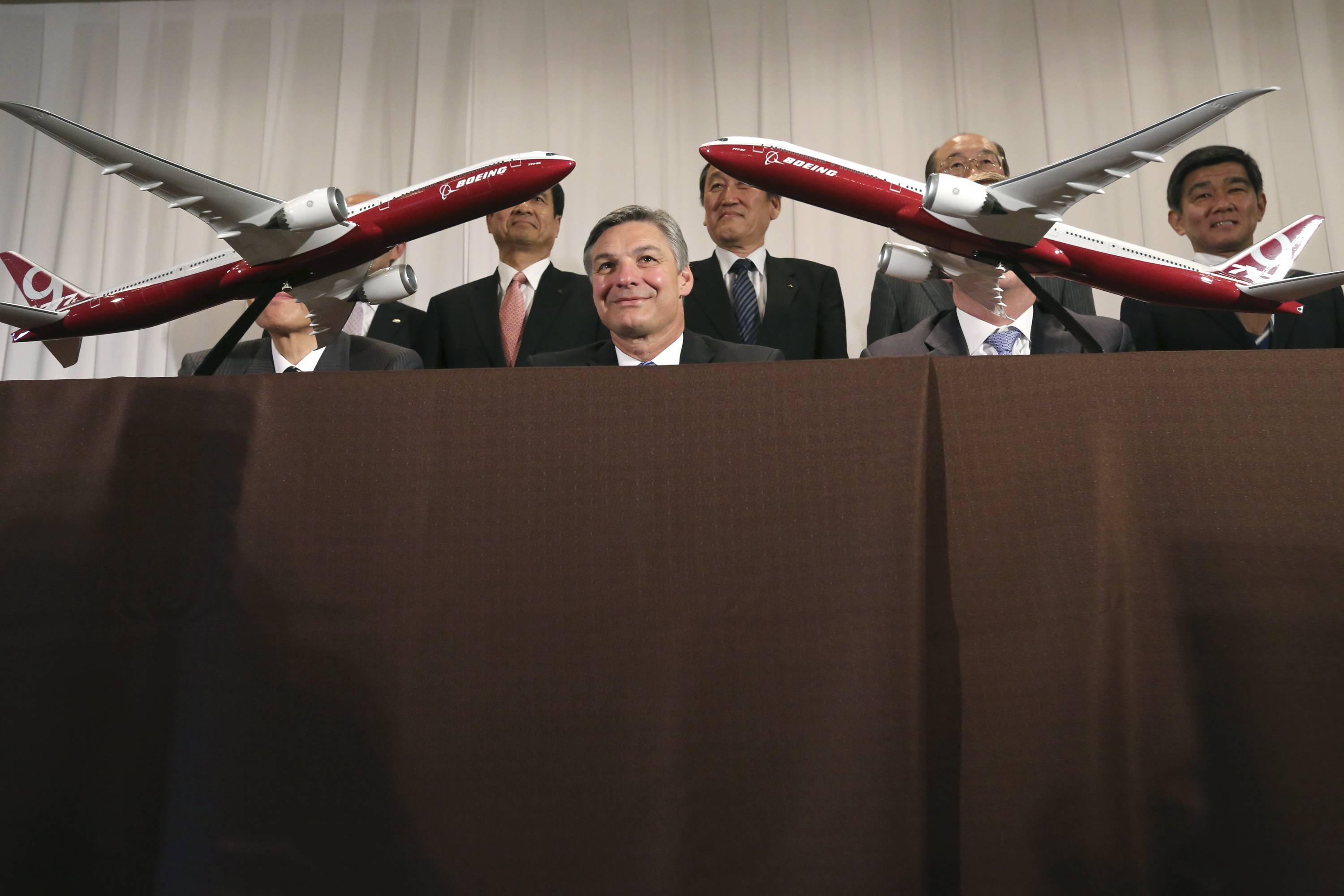 Ray Conner, center, vice chairman of The Boeing Company and president and chief executive officer of Boeing Commercial Airplanes, and representatives of Boeing and five Japanese companies after signing a deal to manufacture key components for Boeing's twin aisle 777X jets in Tokyo, Thursday.
