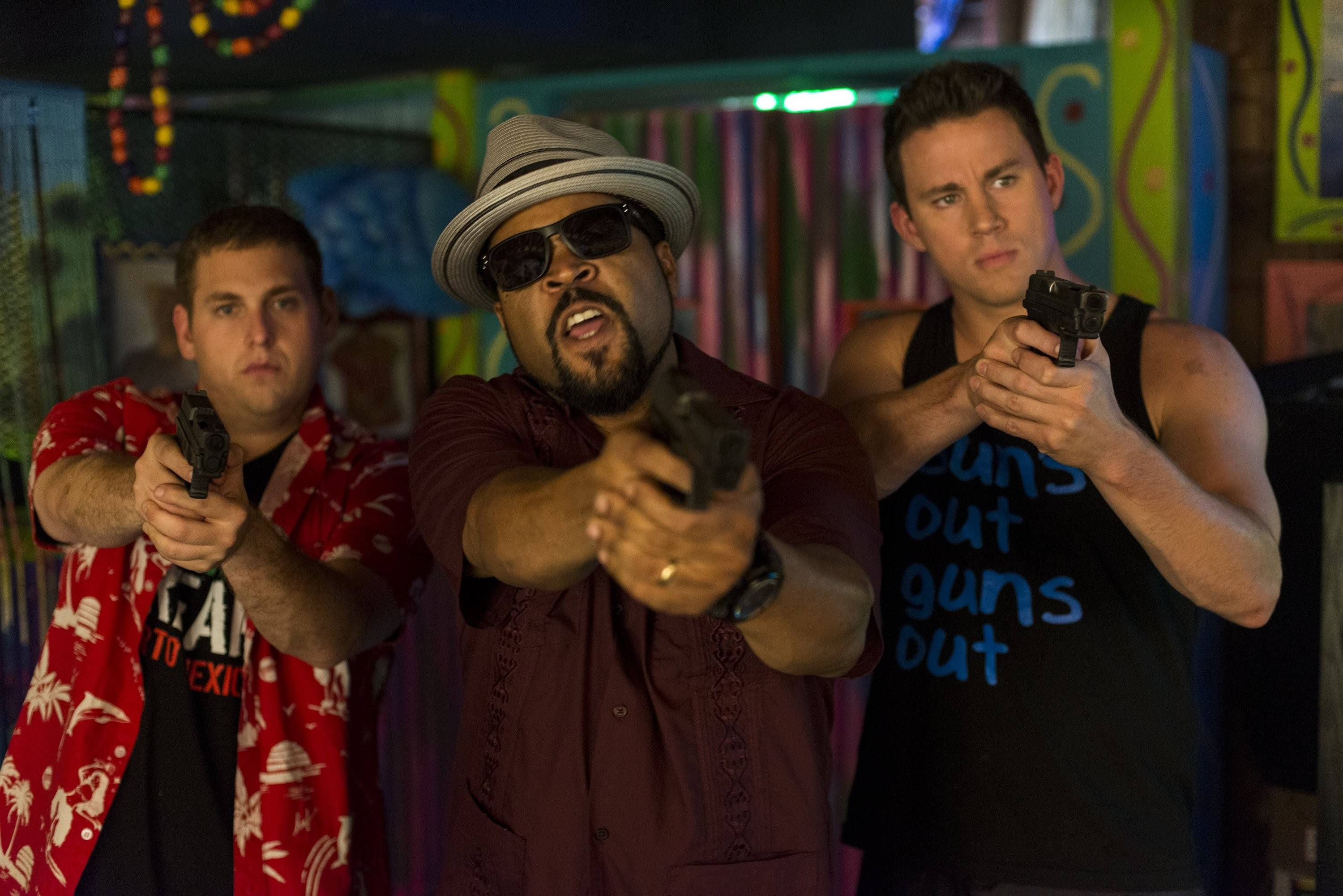 "Schmidt (Jonah Hill), left, and Jenko (Channing Tatum) flank their captain (Ice Cube) in the comedy sequel ""22 Jump Street."""