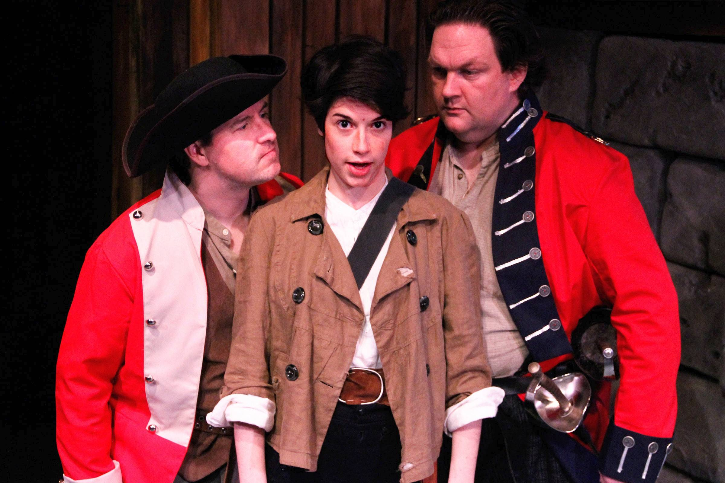 "Sgt. Jackrum (Christopher M. Walsh), right, and Cpl. Strappi (John Ferrick) recruit a young Oliver (in reality, Sarah Price's Polly) into the hapless Borogravian army in ""Monstrous Regiment,"" Lifeline Theatre's stage adaptation of Terry Pratchett's Discworld novel."