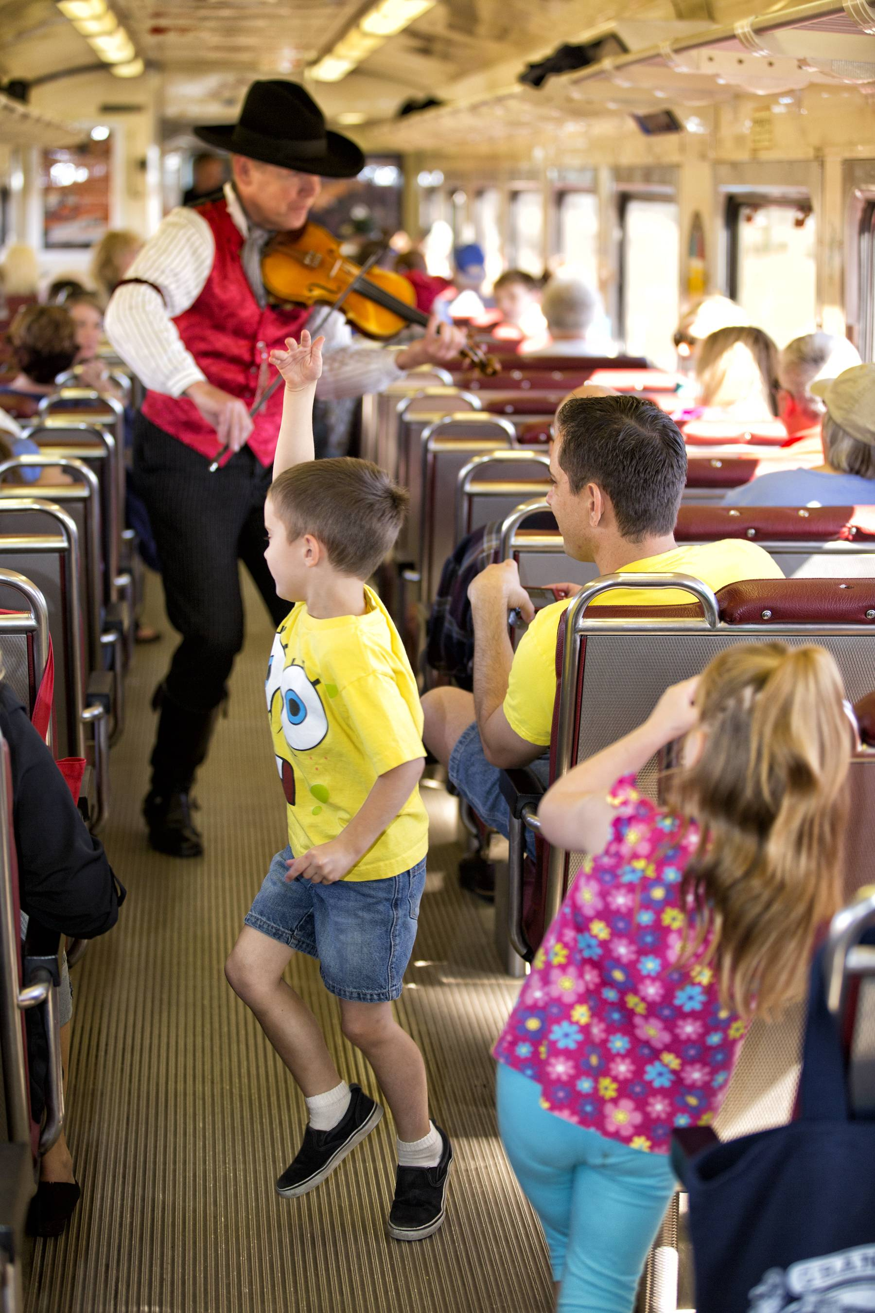 A performer plays violin onboard the railway train on its daily run between Williams, Arizona, and the Grand Canyon's South Rim.