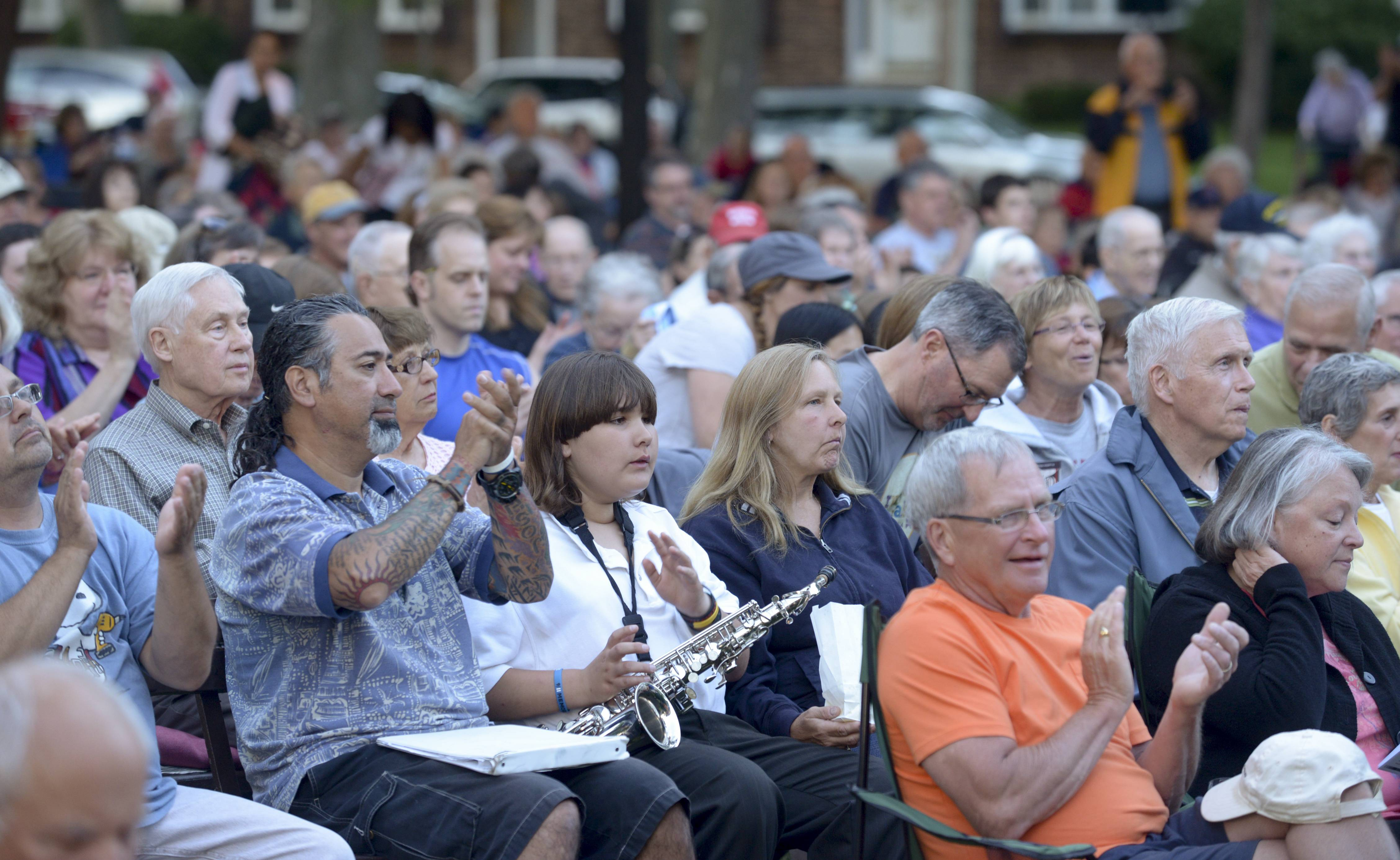 A large crowd turned out to listen and watch the Wheaton Municipal Band kick off their 2014 summer season at Memorial Park in Wheaton Thursday evening.