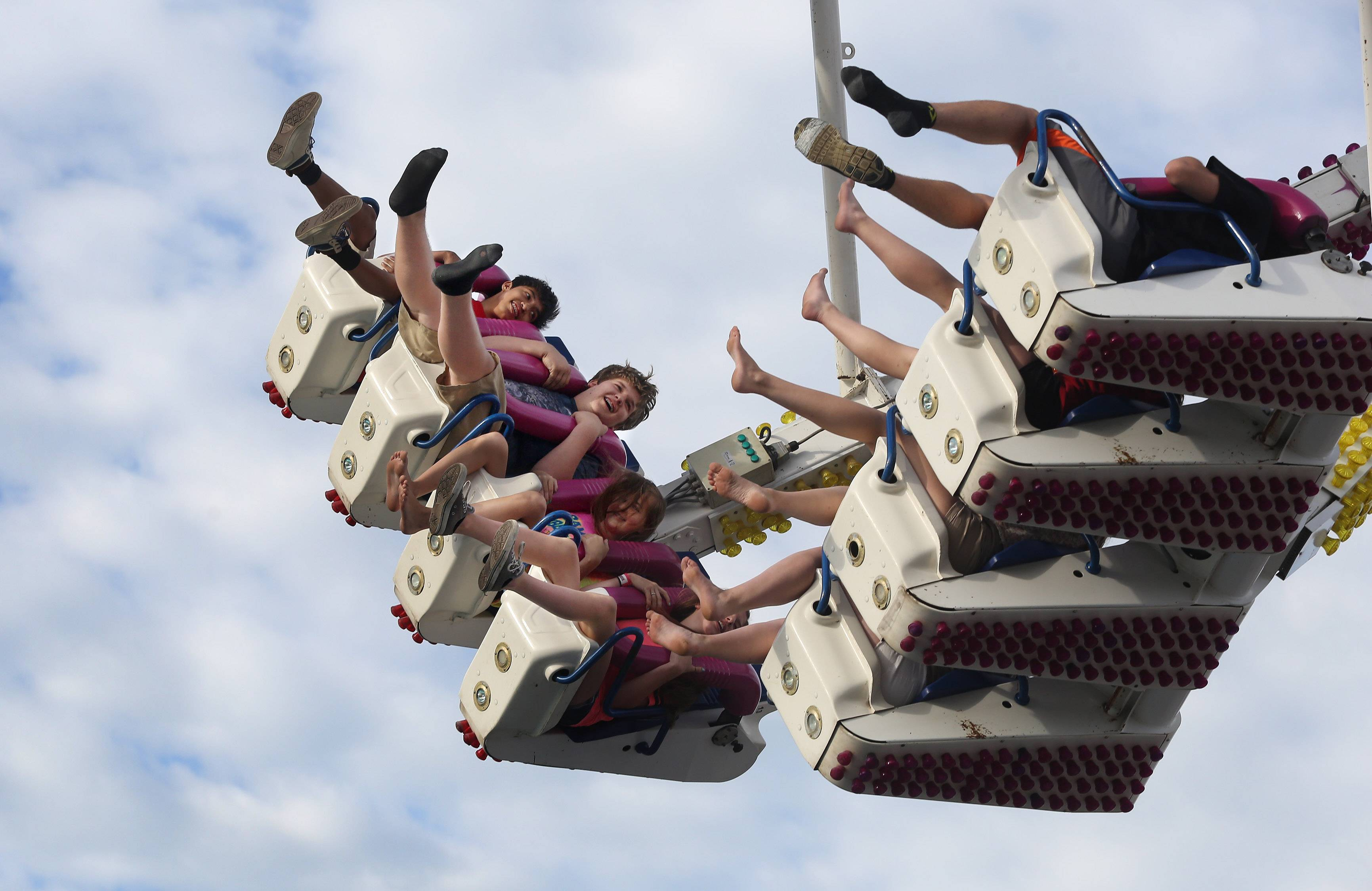 Kids have fun on the Freak Out ride during the first day of the Libertyville Days Festival on Thursday.