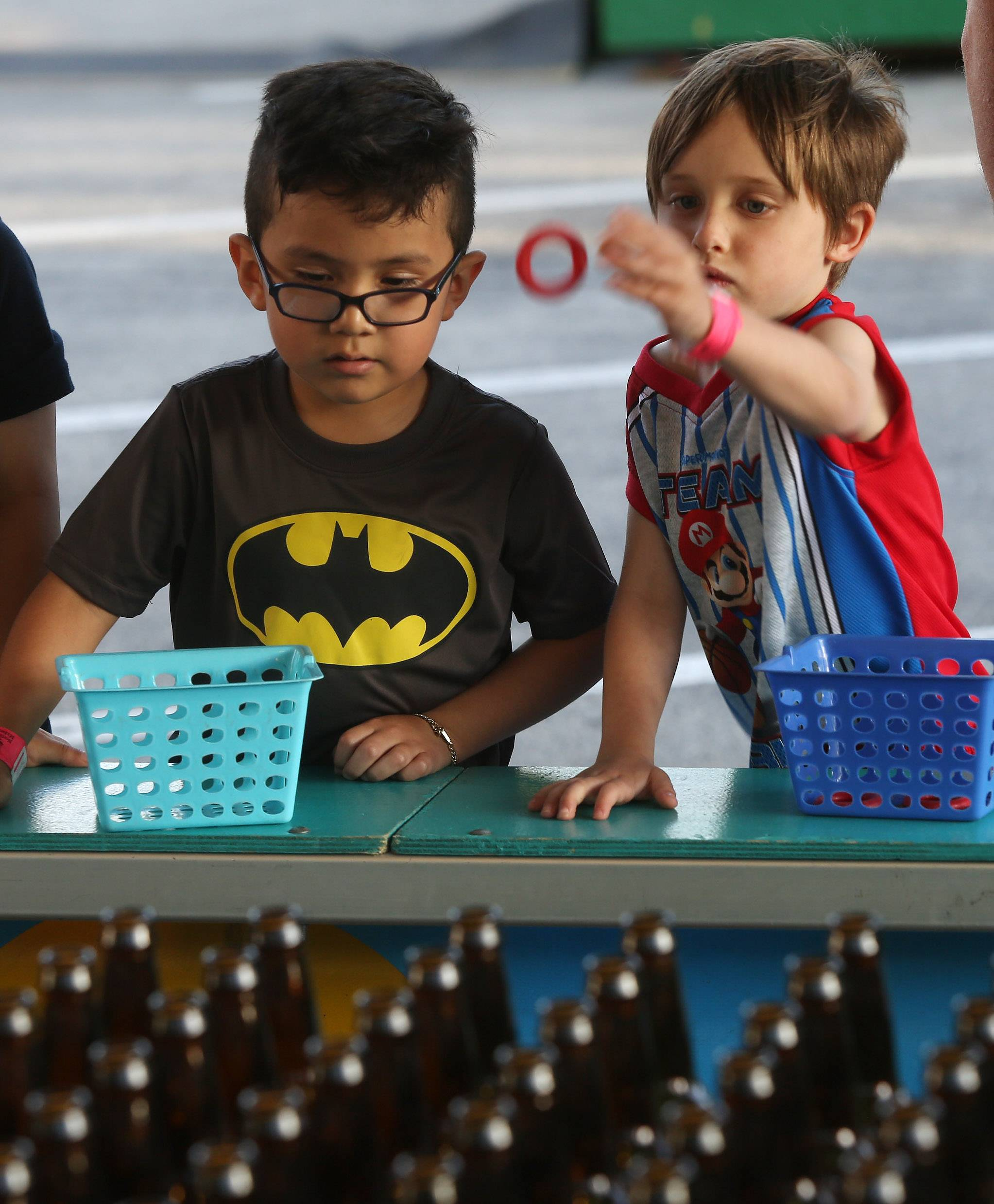 Husai Morales, 5, of Mundelein and Mathias Klemp, 6, of Libertyville play a rings game on the midway during the first day of the Libertyville Days Festival on Thursday.
