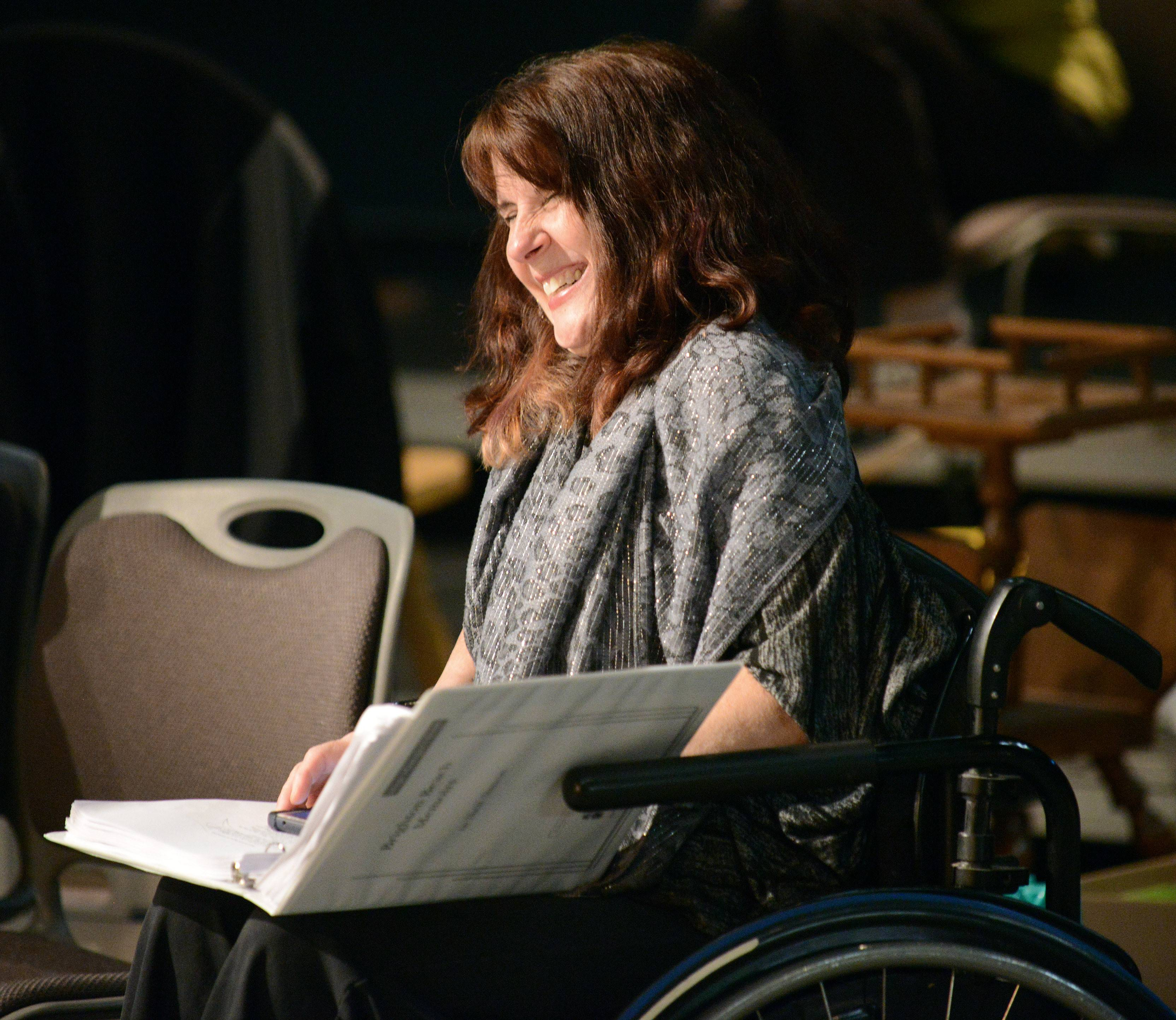 "Linda Collins enjoys a humorous sketch as she follows the script of Neil Simon's ""Brighton Beach Memoirs"" during a dress rehearsal Tuesday. The play opens Friday."