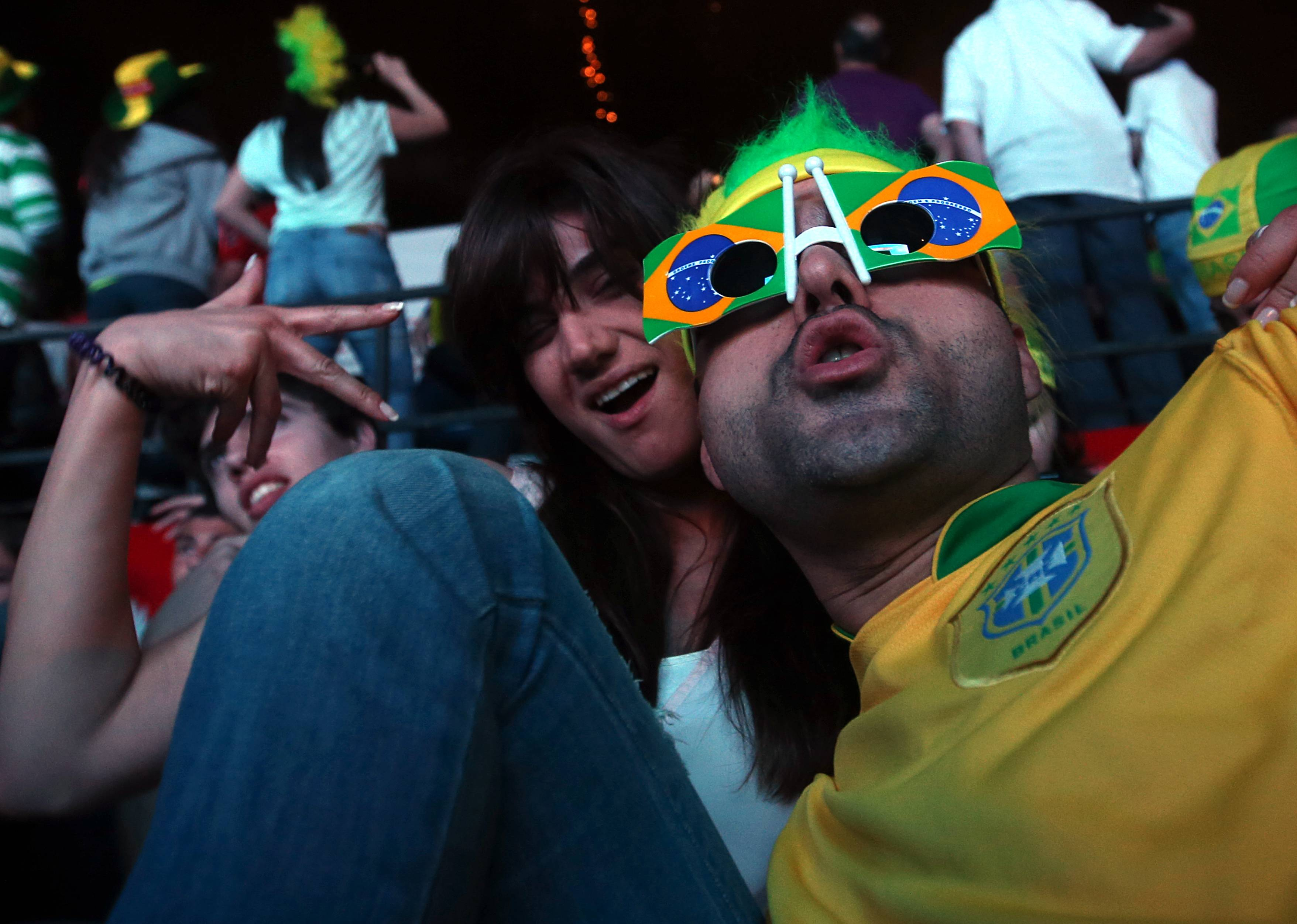 Lebanese soccer fans cheer during the first soccer match of the World Cup between Brazil and Croatia, at a fan park, in downtown Beirut, Lebanon.