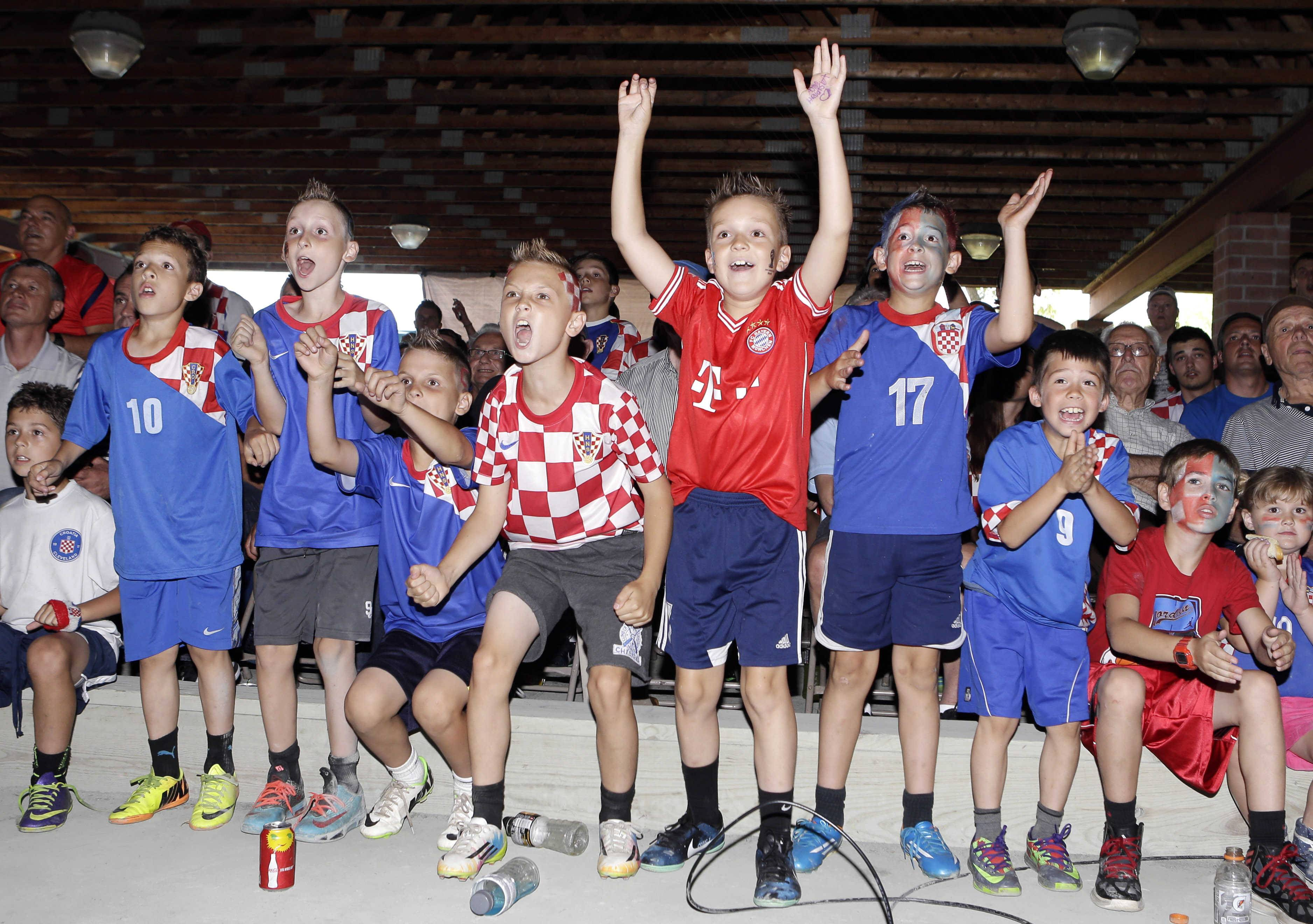 Children cheer for Croatia as they watch the world cup match between Croatia and Brazil at the Croatia Cleveland Soccer Club Thursday, June 12, 2014, in Eastlake, Ohio.