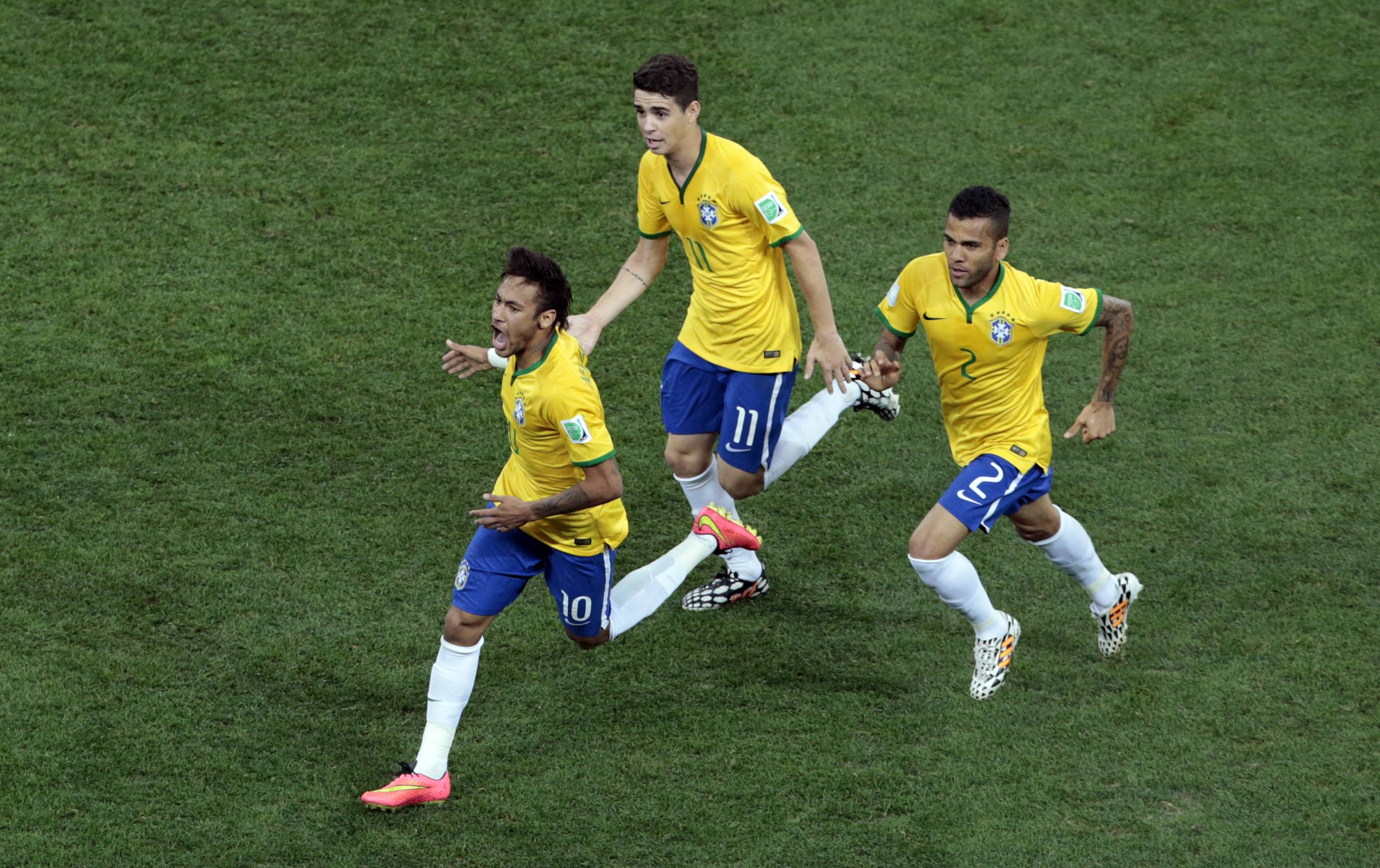 Brazil's Neymar, left, celebrates scoring his side's first goal during the group A World Cup soccer match between Brazil and Croatia, the opening game of the tournament, in the Itaquerao Stadium in Sao Paulo.