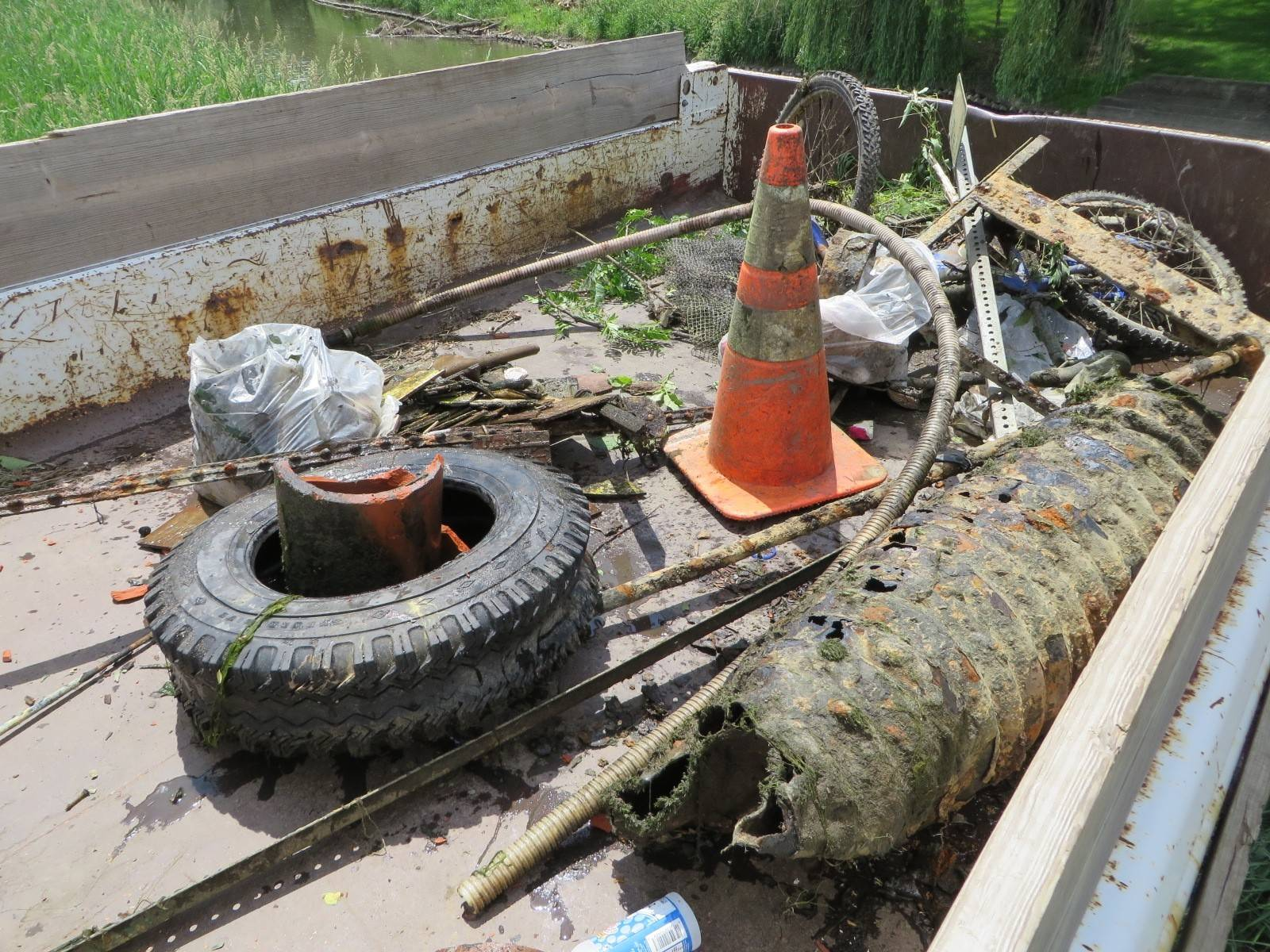Among the debris removed from Salt Creek last weekend: a tire, construction cone and bicycle. Organizers say volunteers removed some 72 cubic yards of garbage during the 20th annual cleanup effort.