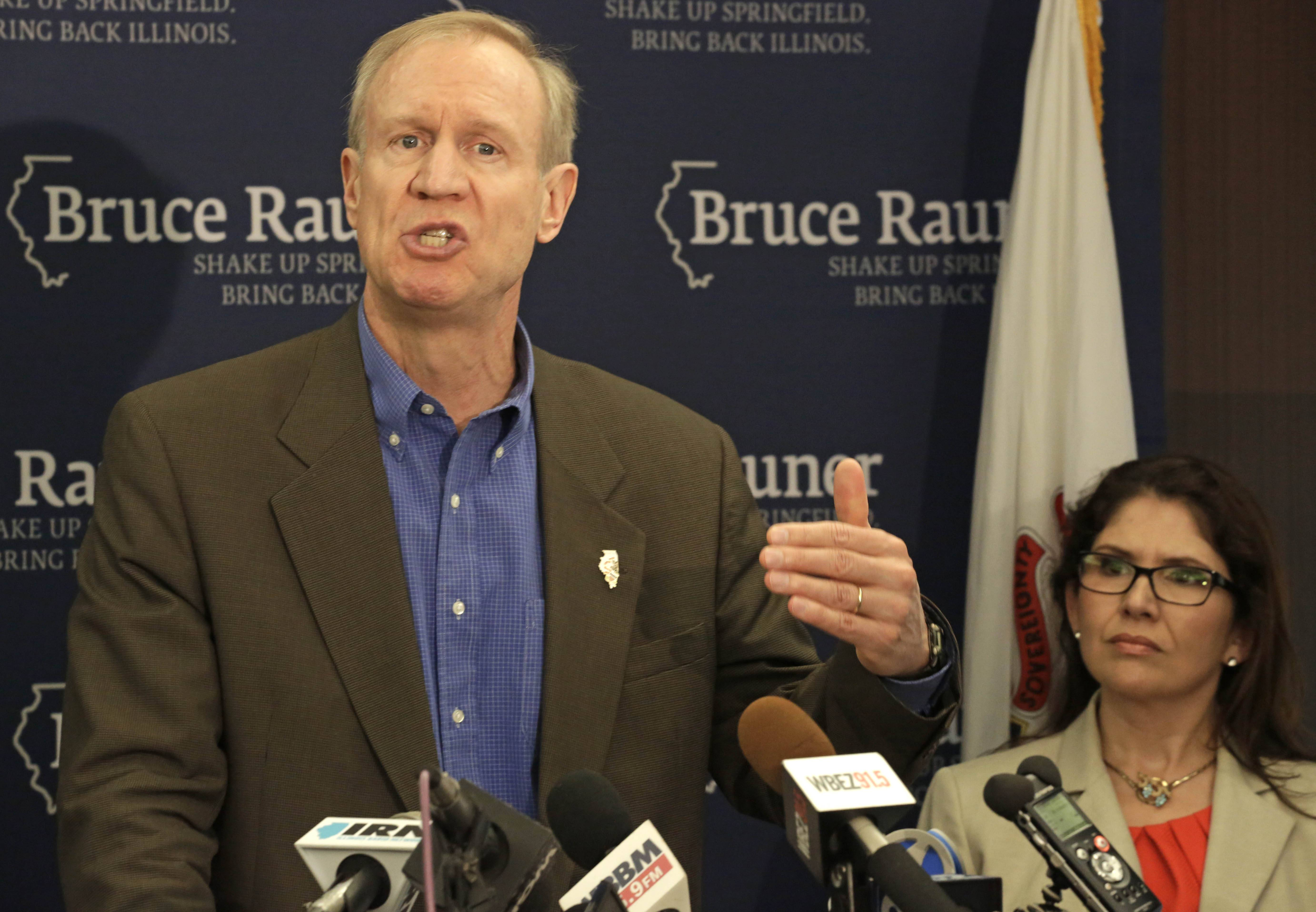 Republican governor candidate Bruce Rauner speaks at a news conference accompanied by his running mate, Evelyn Sanguinetti of Wheaton, on Thursday in Chicago. He revealed some proposals for cutting what he calls wasteful spending in Illinois.