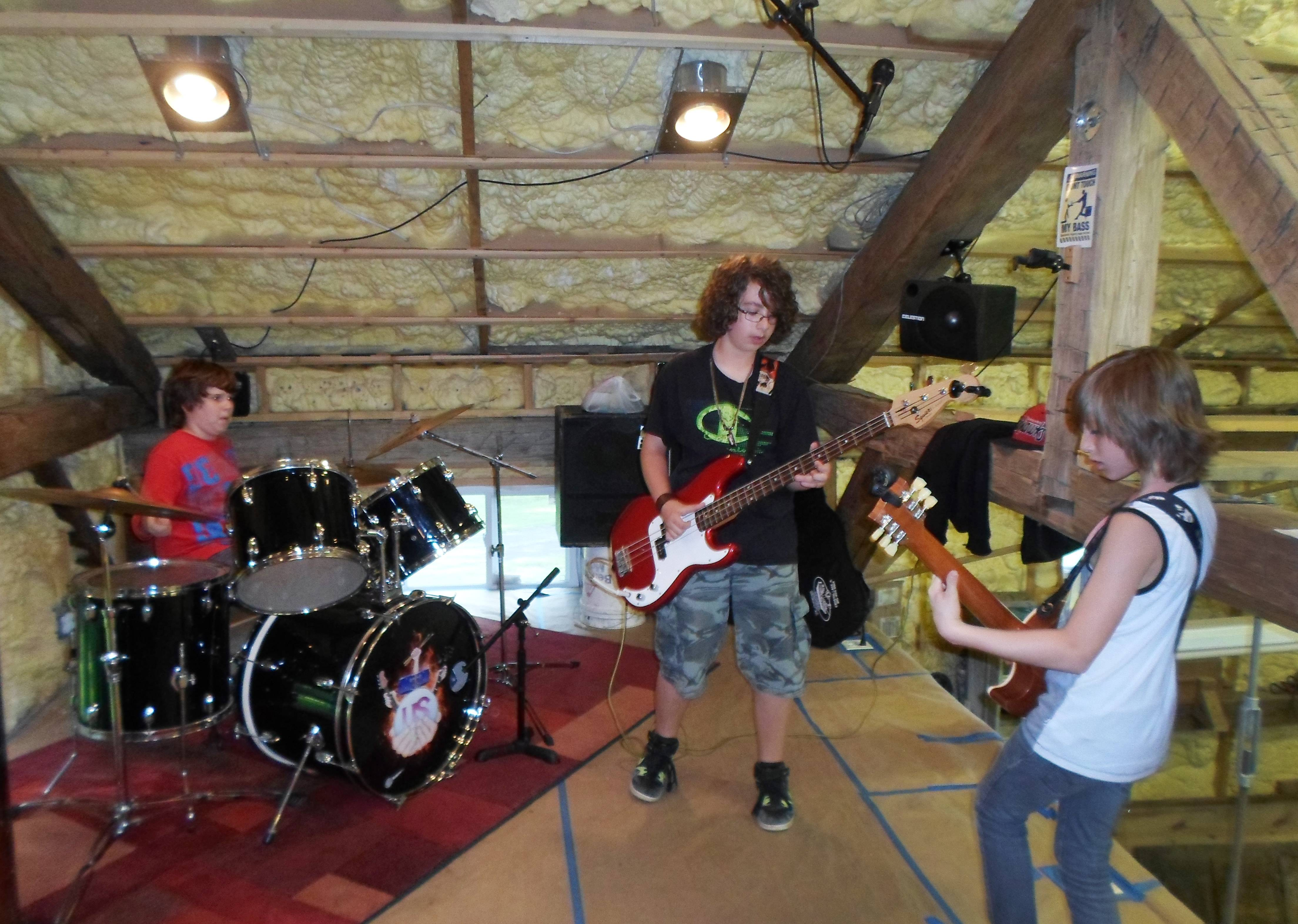 Member of the band US from Rhys Junas, left, Ryan Zurick and Axel Ellis rehearse a song.