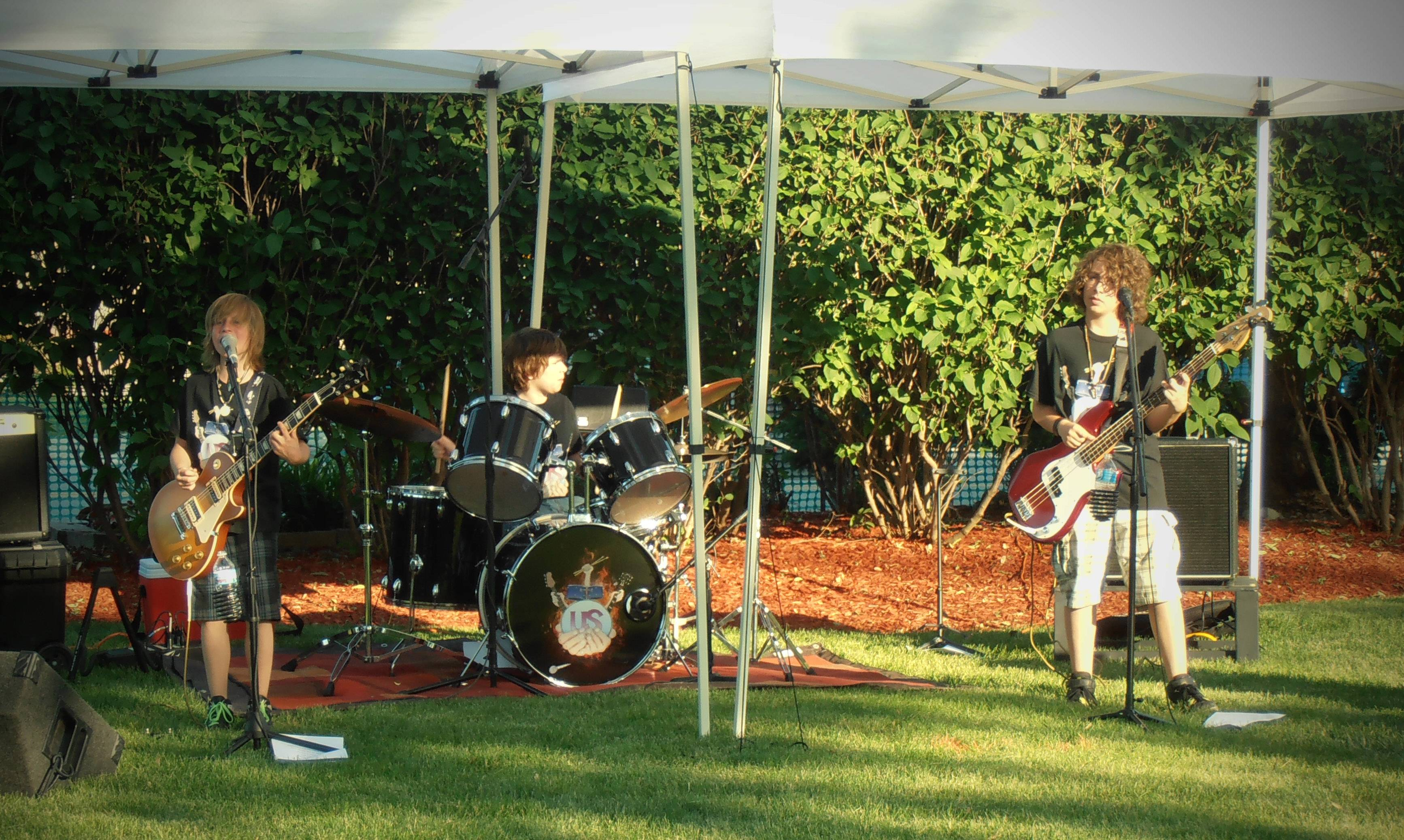 The band US playing at the Lake Villa Celebration of Summer Teen Night in Lehmann Park.