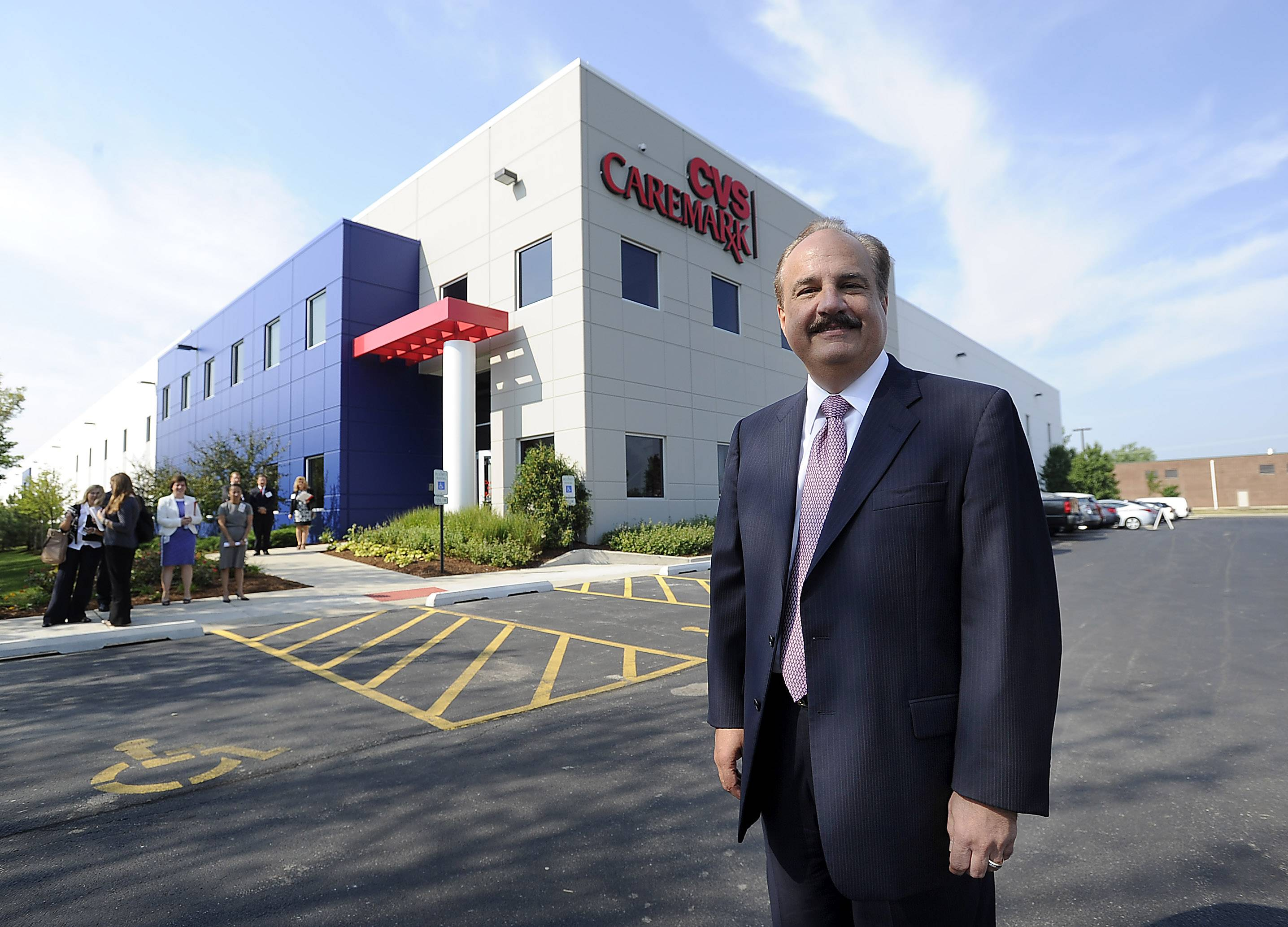Larry Merlo, CEO of CVS Caremark, stands outside the customer Center on Wall Street in Mount Prospect.