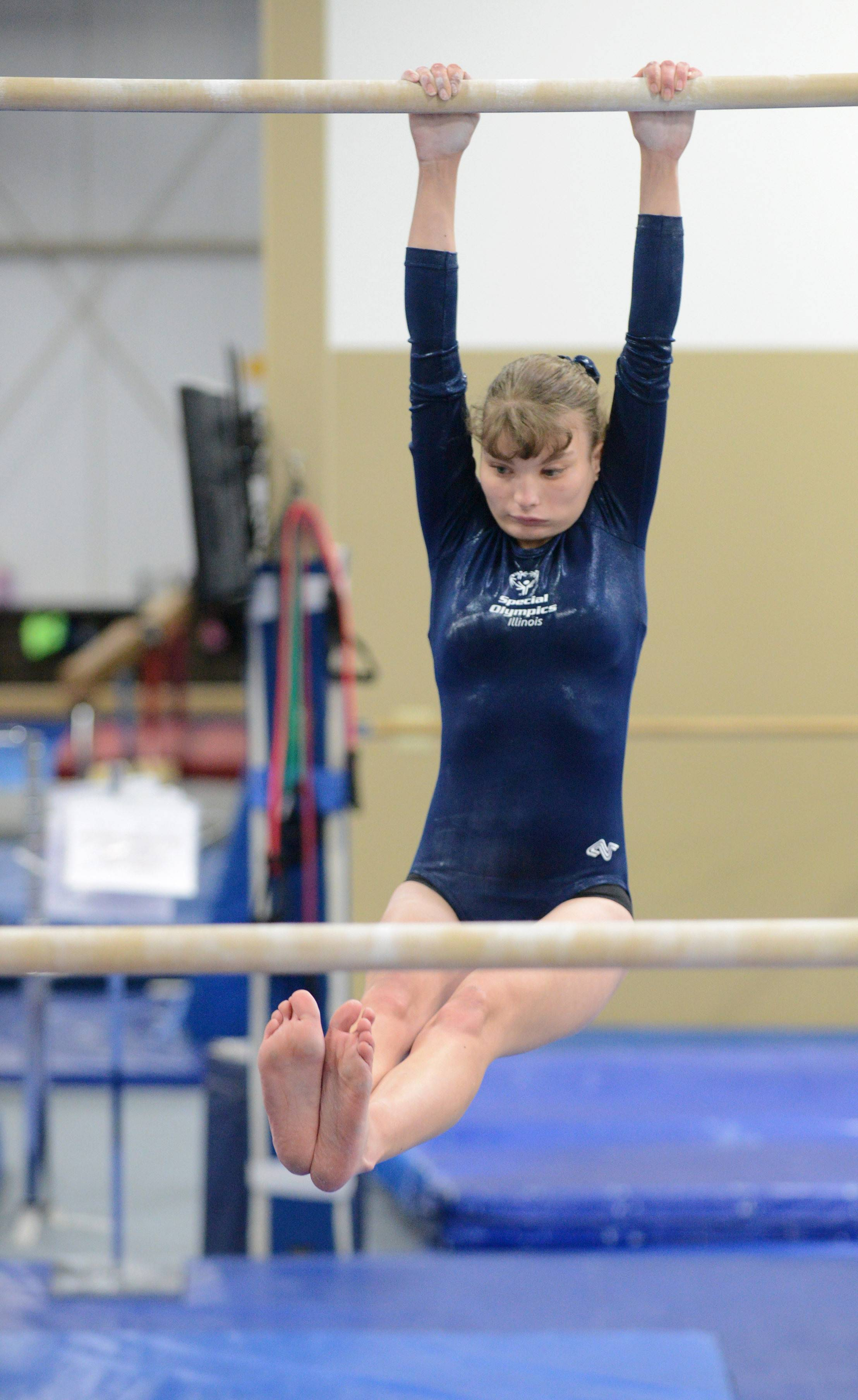 Special Olympics gymnast Janna Blowers, 19, of Campton Hills practices her routine on the uneven bars at Excel Gymnastics in Geneva. She will be competing in the 2014 USA Games in New Jersey next week. A nine-time state finalist, it'll be her first appearance in the national games.