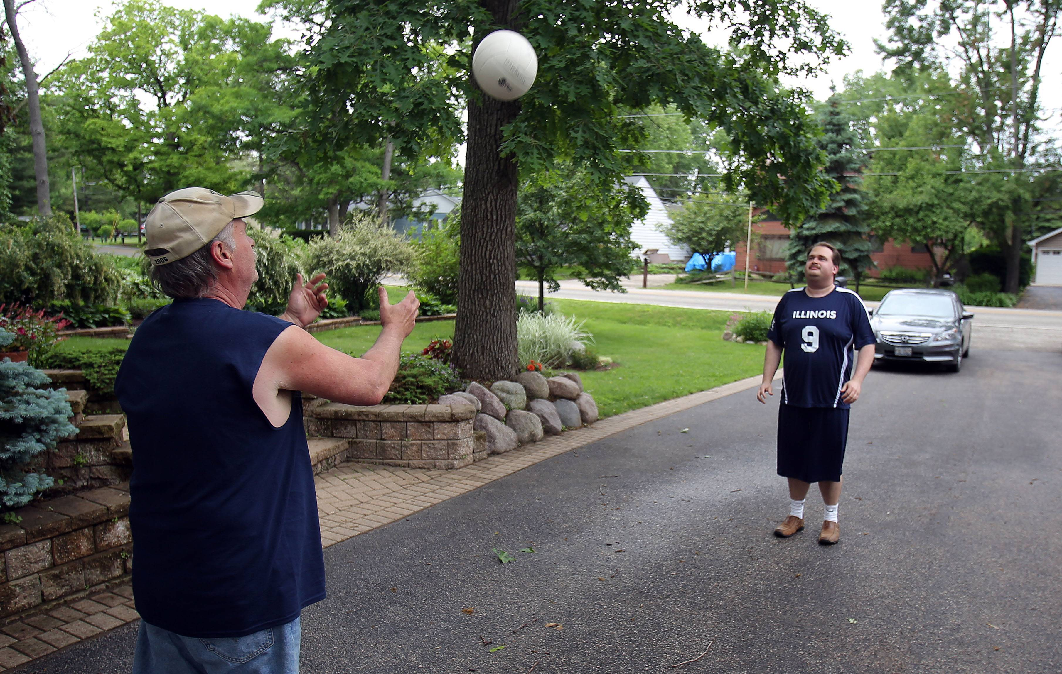 Jason Coy, right, of Wildwood practices volleyball in his driveway with his father, Marion. Jason will represent Illinois on the volleyball team at the upcoming Special Olympics 2014 USA Games in New Jersey.