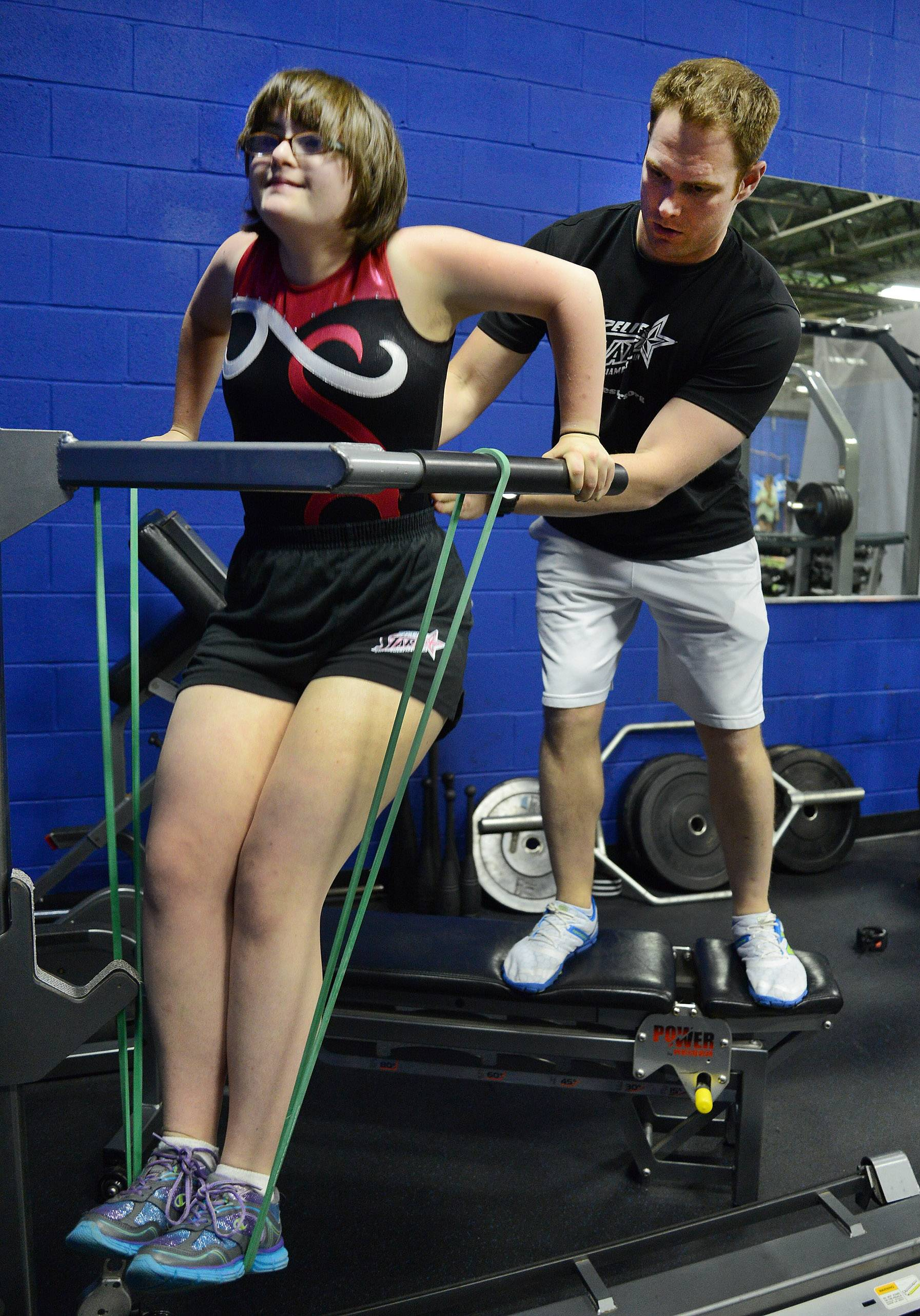 Gymnast Karlee Darow works with Jason Domnanovich, director of sports performance for The Academy of Athletic Advancement in Mount Prospect, while preparing for the upcoming Special Olympics 2014 USA Games in New Jersey.