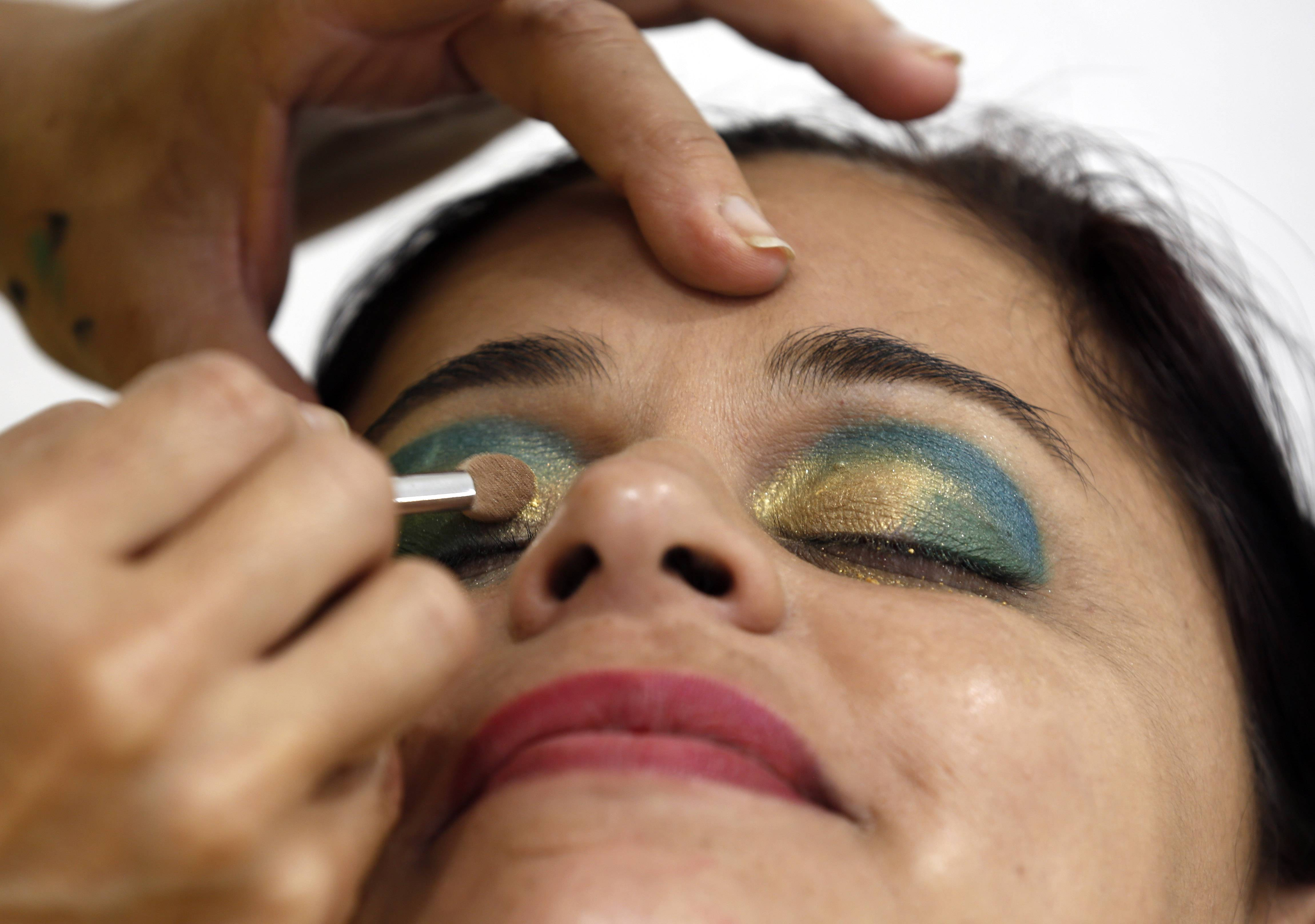 One football fan sports eye shadow in the colors of Brazil's flag ahead of the World Cup opening game, in Recife, Brazil.
