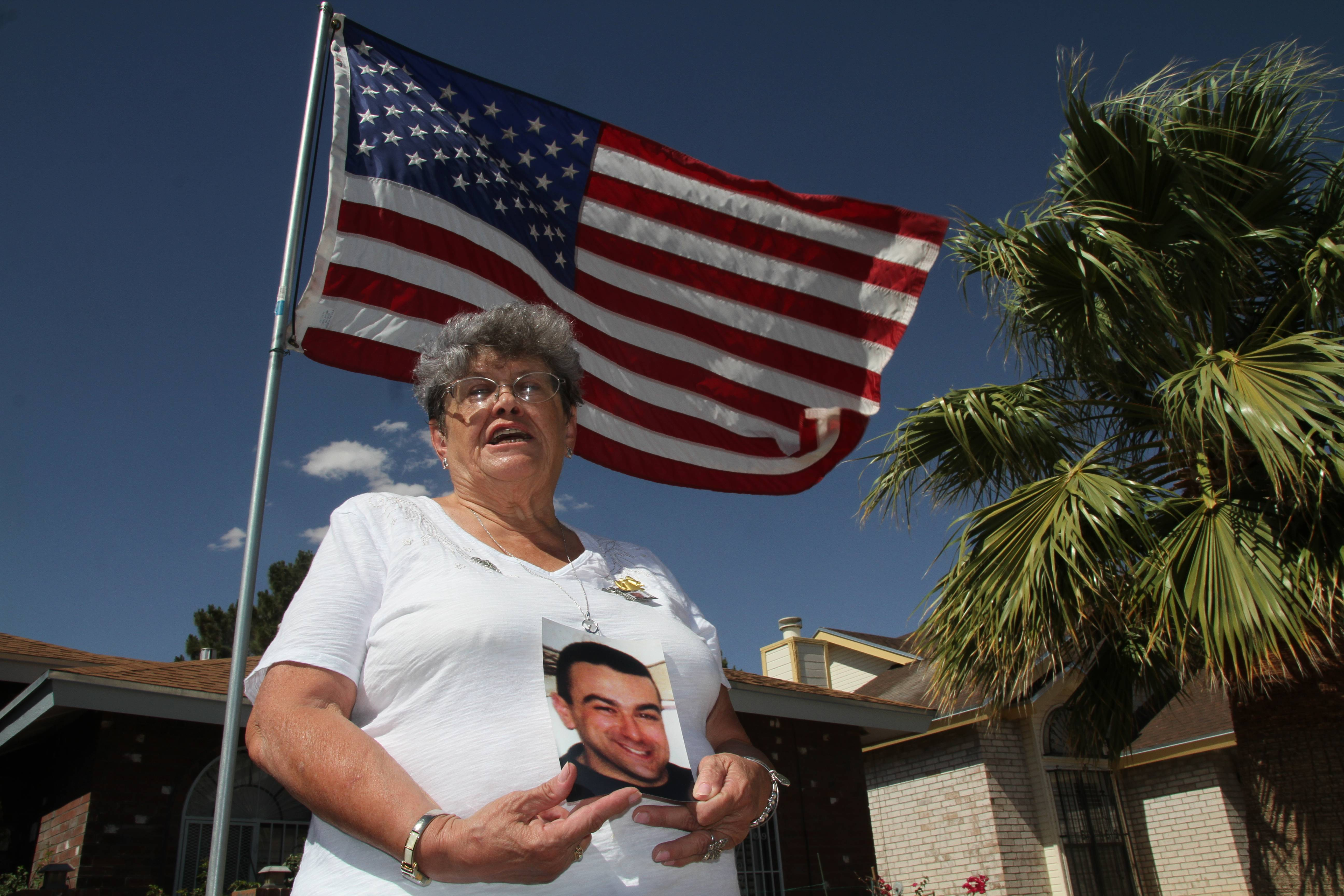 "Lillian ""Bonnie"" D'Amico, poses for a photograph while holding a photo of her son Nicholas D'Amico in El Paso, Texas. Her son killed himself while waiting for a an appointment with a psychiatrist. Some Veterans Affairs facilities in Texas have among the longest wait-times in the nation for those trying to see a doctor for the first time, according to federal data released Monday."