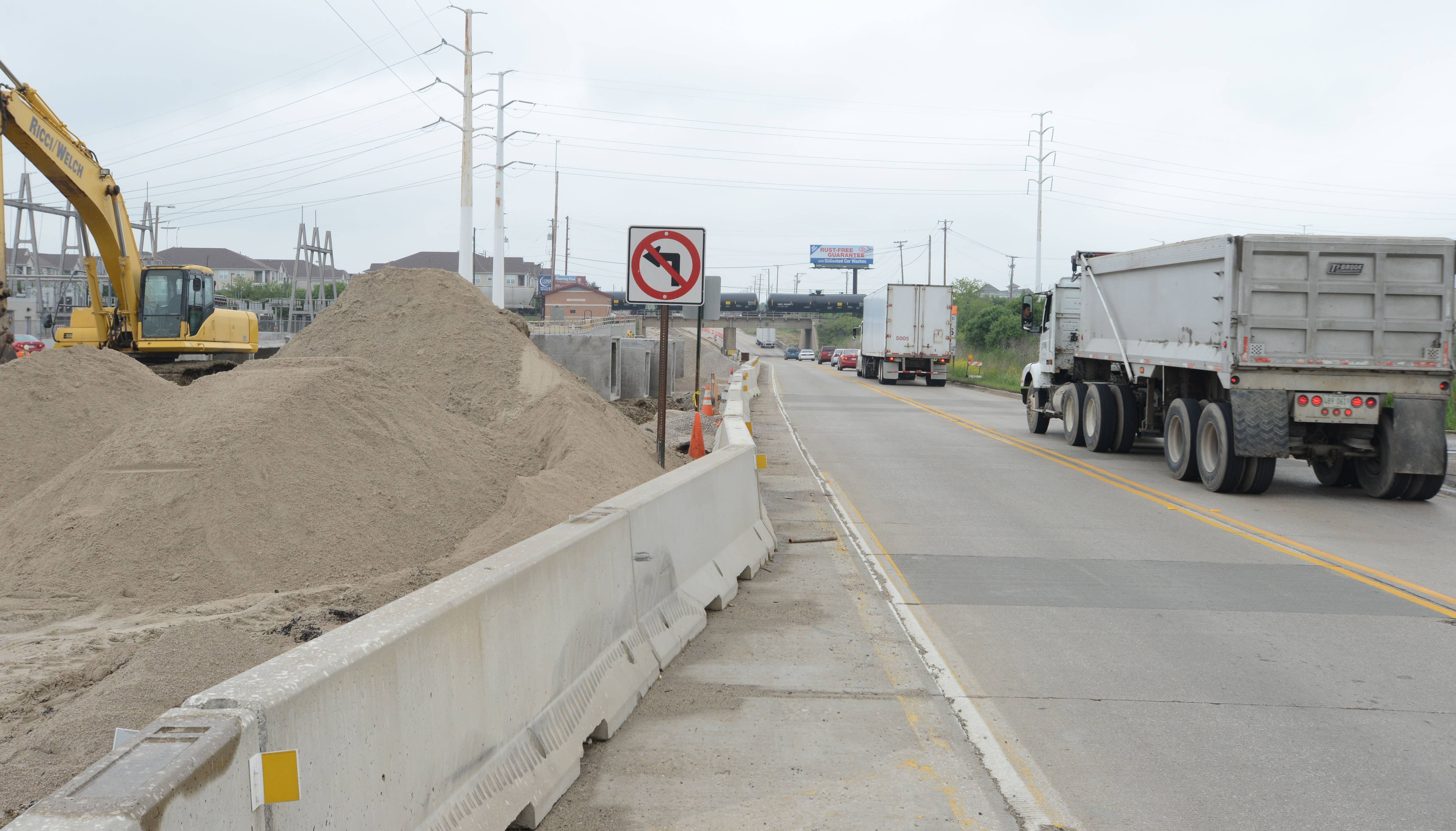 Crews will be installing a box culvert near the Burlington Northern Santa Fe Railroad underpass to carry a creek under the road.