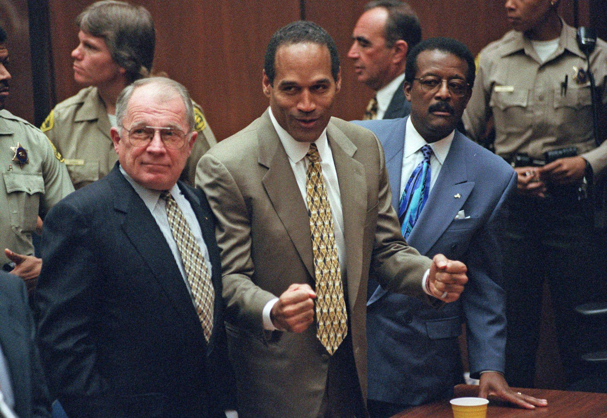 O.J. Simpson reacts to being found not guilty of murdering his ex-wife Nicole Brown Simpson and Ron Goldman as he stands between defense attorneys F. Lee Bailey, left, and Johnnie Cochran Jr. on Oct. 3, 1995. Later found liable of the murders in civil court, Simpson now is in a Nevada prison on robbery charges.
