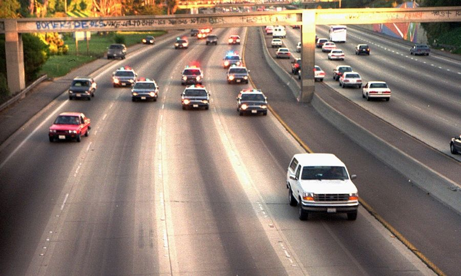 "On June 17, 1994, this scene of a white Ford Bronco, driven by Al Cowlings with passenger O.J. Simpson, being followed by Los Angeles police cars dominated TV news coverage and became famous as the ""slow-speed chase."""