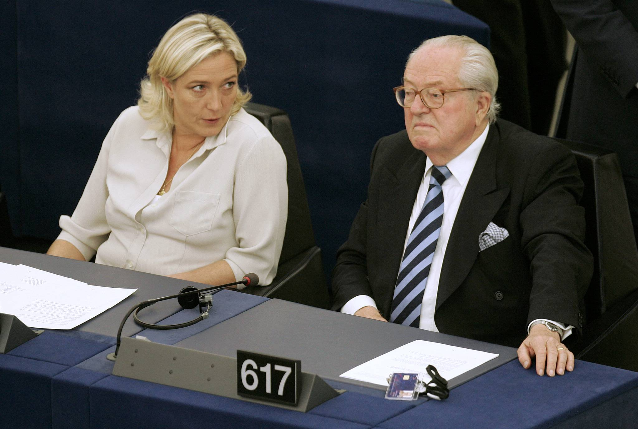 In this July 14, 2009 file photo Jean-Marie Le Pen, right, and his daughter Marine Le Pen sit at the European Parliament, in Strasbourg, eastern France.  A tempest has been unleashed upon the House of Le Pen, the seat of France's rising far right, with the wounded patriarch and founder of the National Front lashing out at his political heir and daughter in a feud over an anti-Semitic smear.