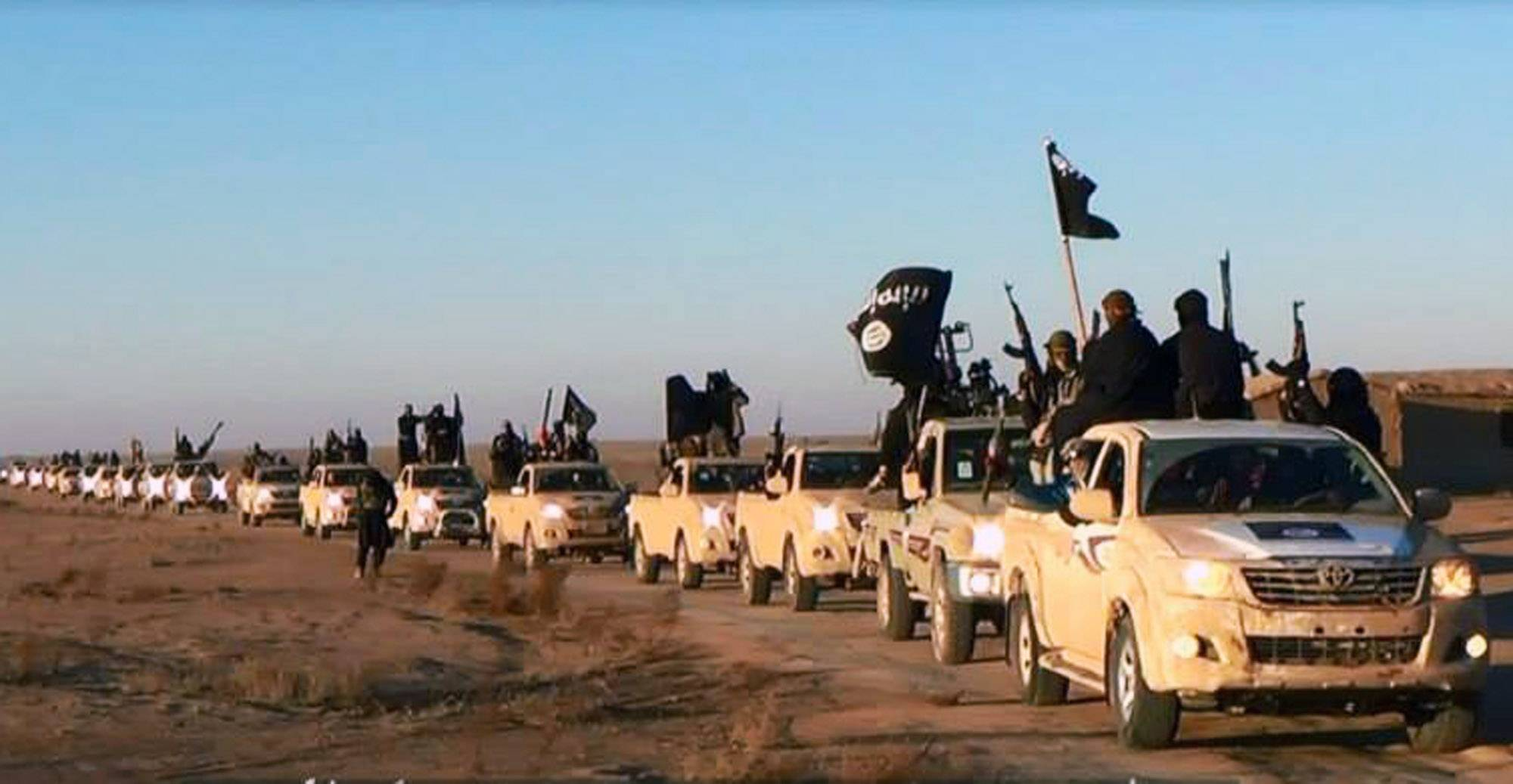 This file image posted on a militant website on Tuesday, Jan. 7, 2014, which is consistent with AP reporting, shows a convoy of vehicles and fighters from the al-Qaida-linked Islamic State of Iraq and the Levant (ISIL) fighters in Iraq's Anbar Province. The Islamic State was originally al-Qaida's branch in Iraq, but it used Syria's civil war to vault into something more powerful. It defied orders from al-Qaida's central command and expanded its operations into Syria, ostensibly to fight to topple Assad. But it has turned mainly to conquering territory for itself, often battling other rebels who stand in the way.