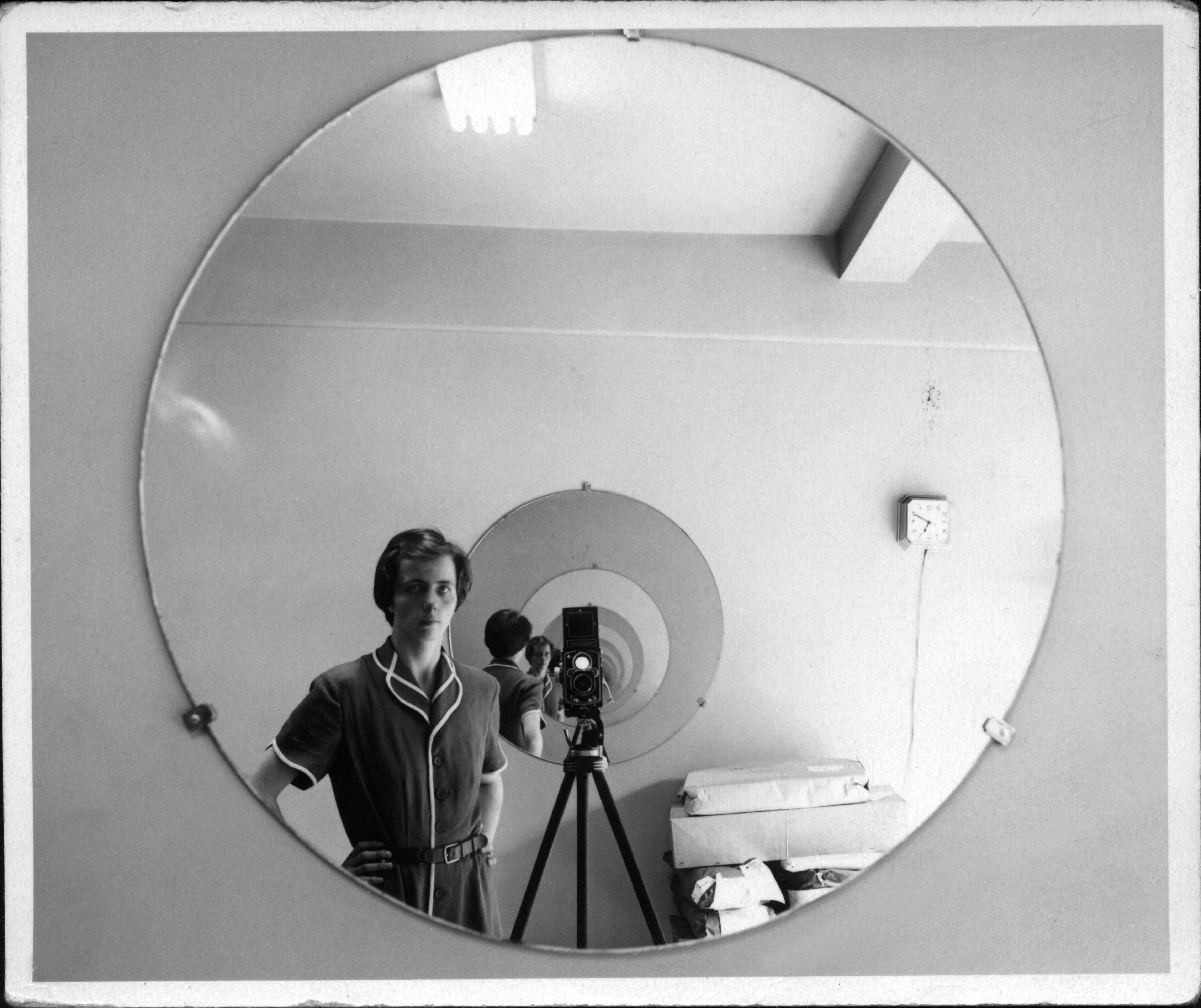 """Vivian Maier, New York (Self-Portrait in Circular Mirrors)"" is a vintage print of a photo Maier shot of herself in the early 1950s."