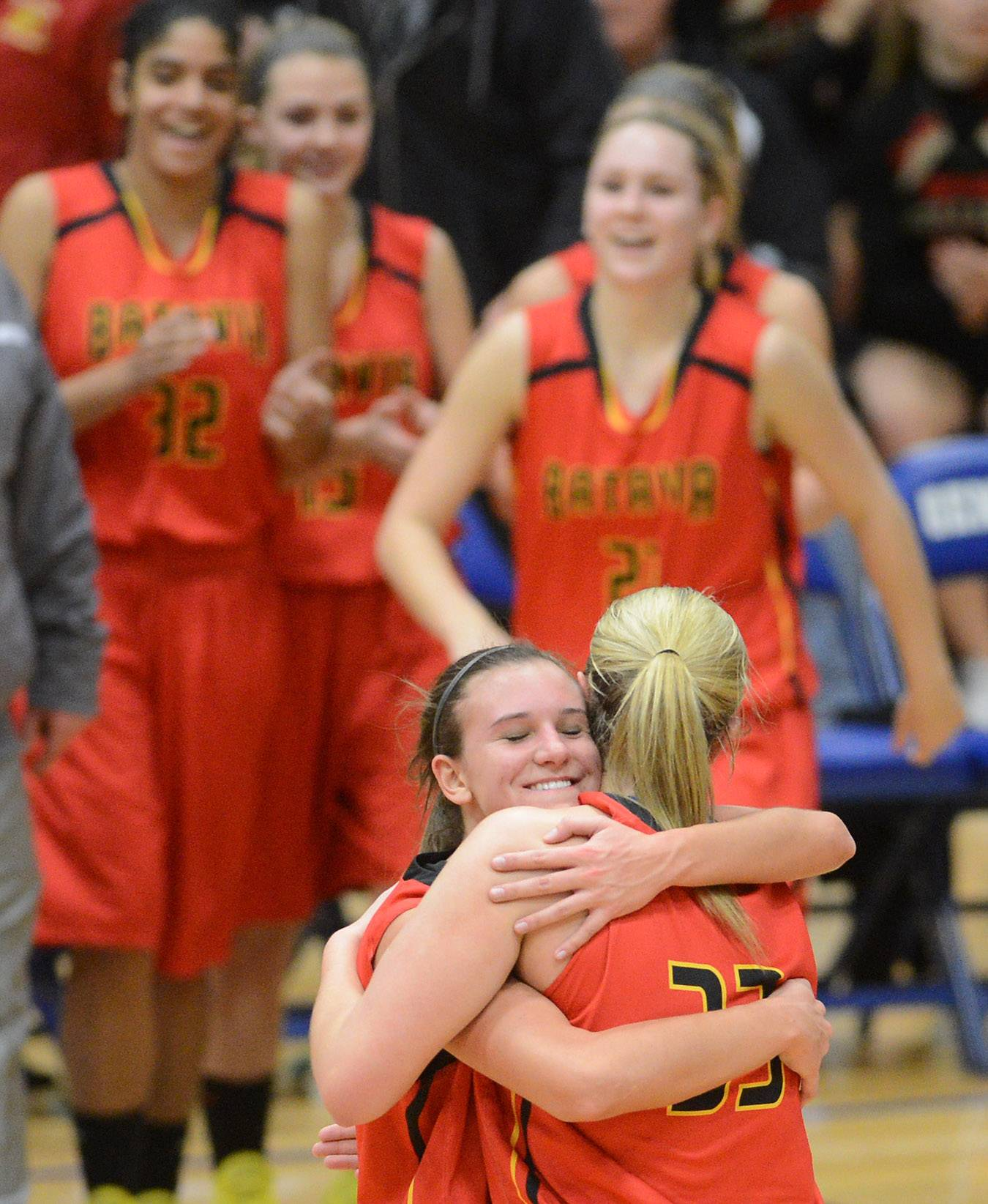 Batavia's Liza Fruendt hugs teammate Erin Bayram after she scored 51 points in a win over Geneva, one of the most memorable moments of the year.