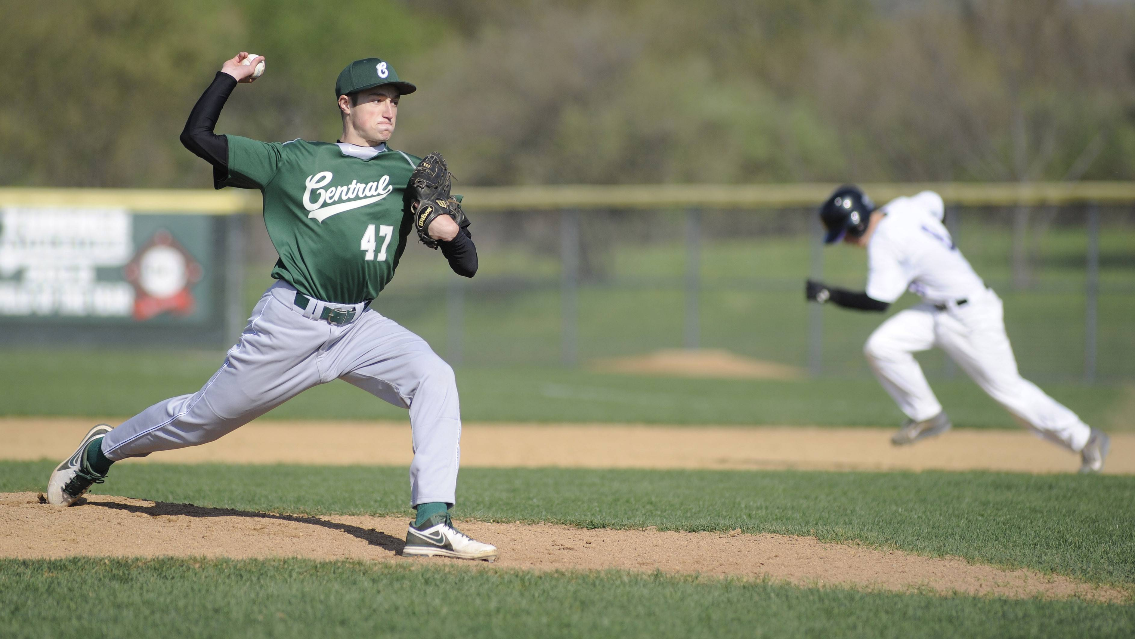 Grayslake Central's Russel Lundius pitches as Hampshire's Michael Merchut sprints for second base.