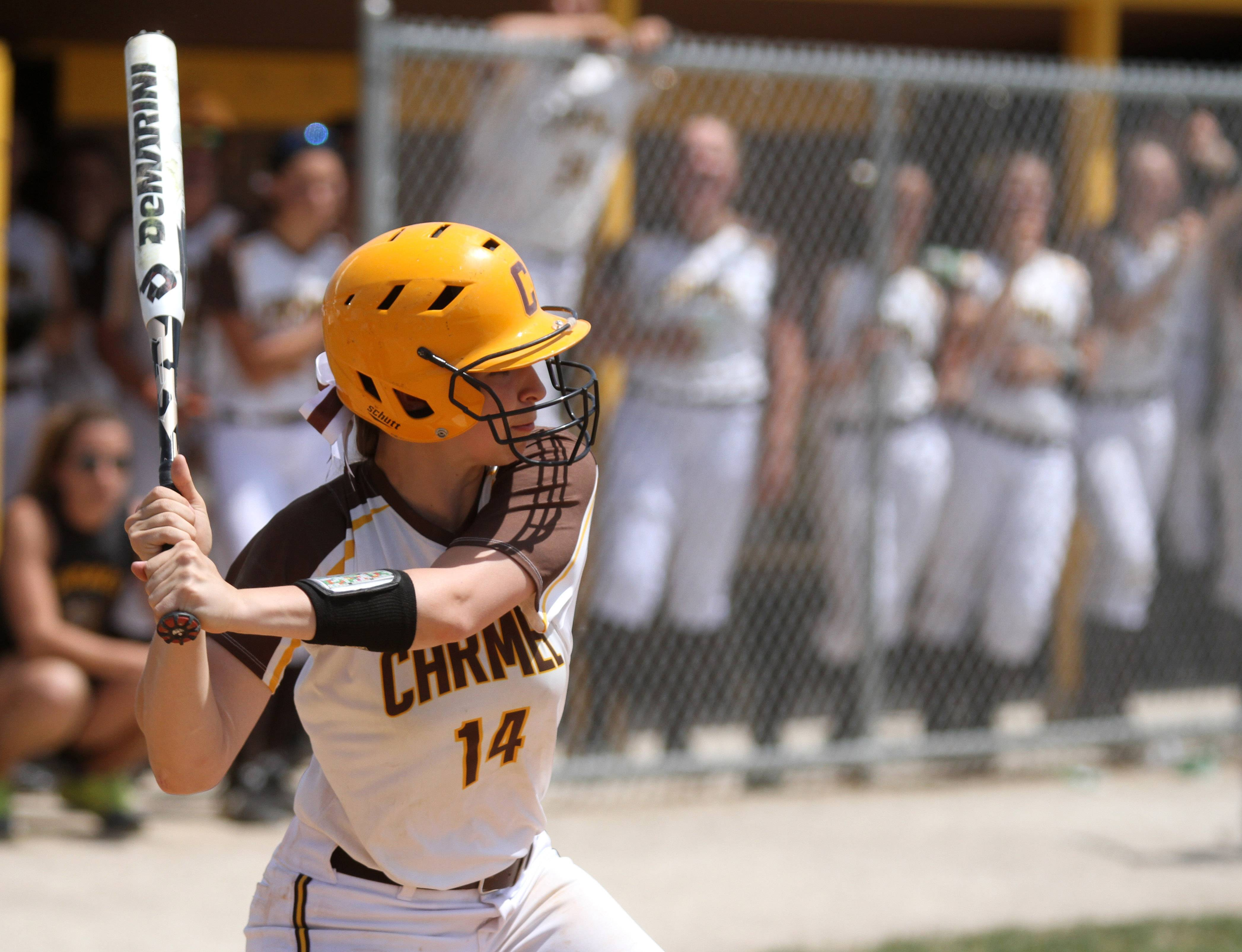 Carmel's Jenny Behan prepares to take a rip during Class 4A regional play against Libertyville.