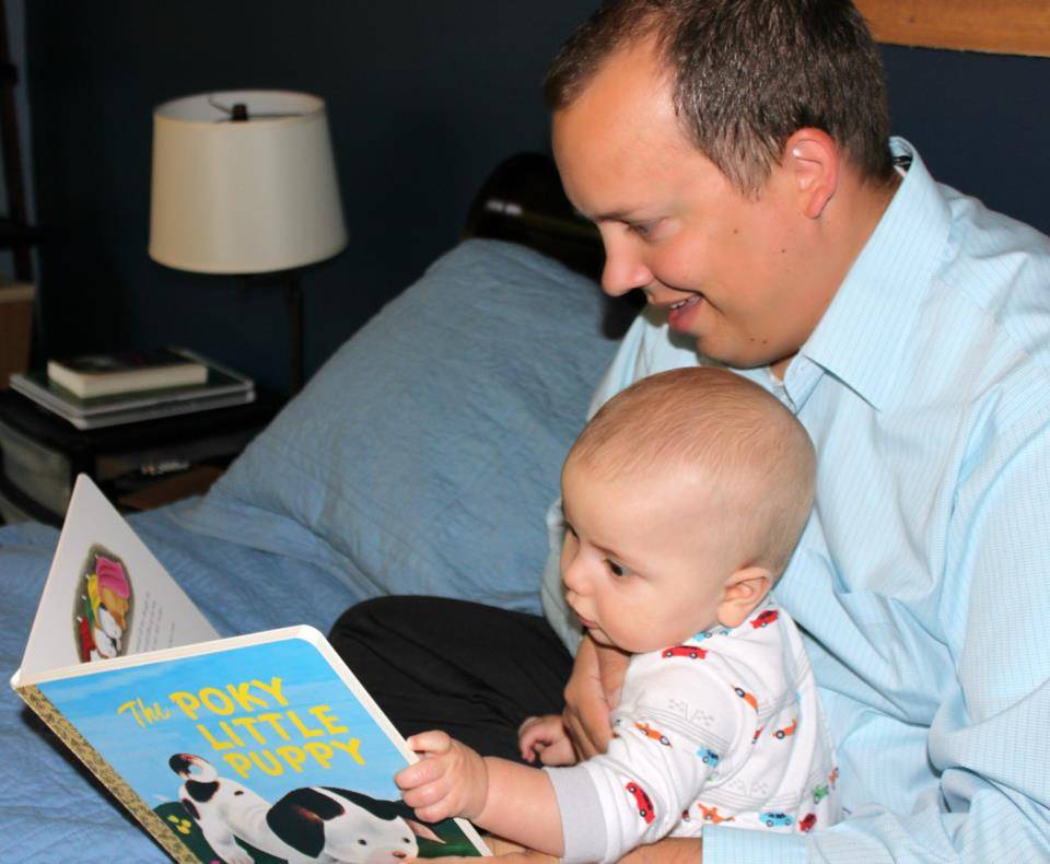 Kane County Board member Kurt Kojzarek reads an Imagination Library book to his son, Robbie.