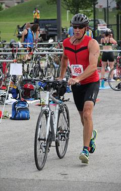 A competitor transitions to his bike during the triathlon.Schaumburg Park District