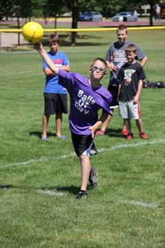 "A youth player on ""Balls of Fury"" throws the ball at a competitor during Dodgeball Days.Schaumburg Park District"