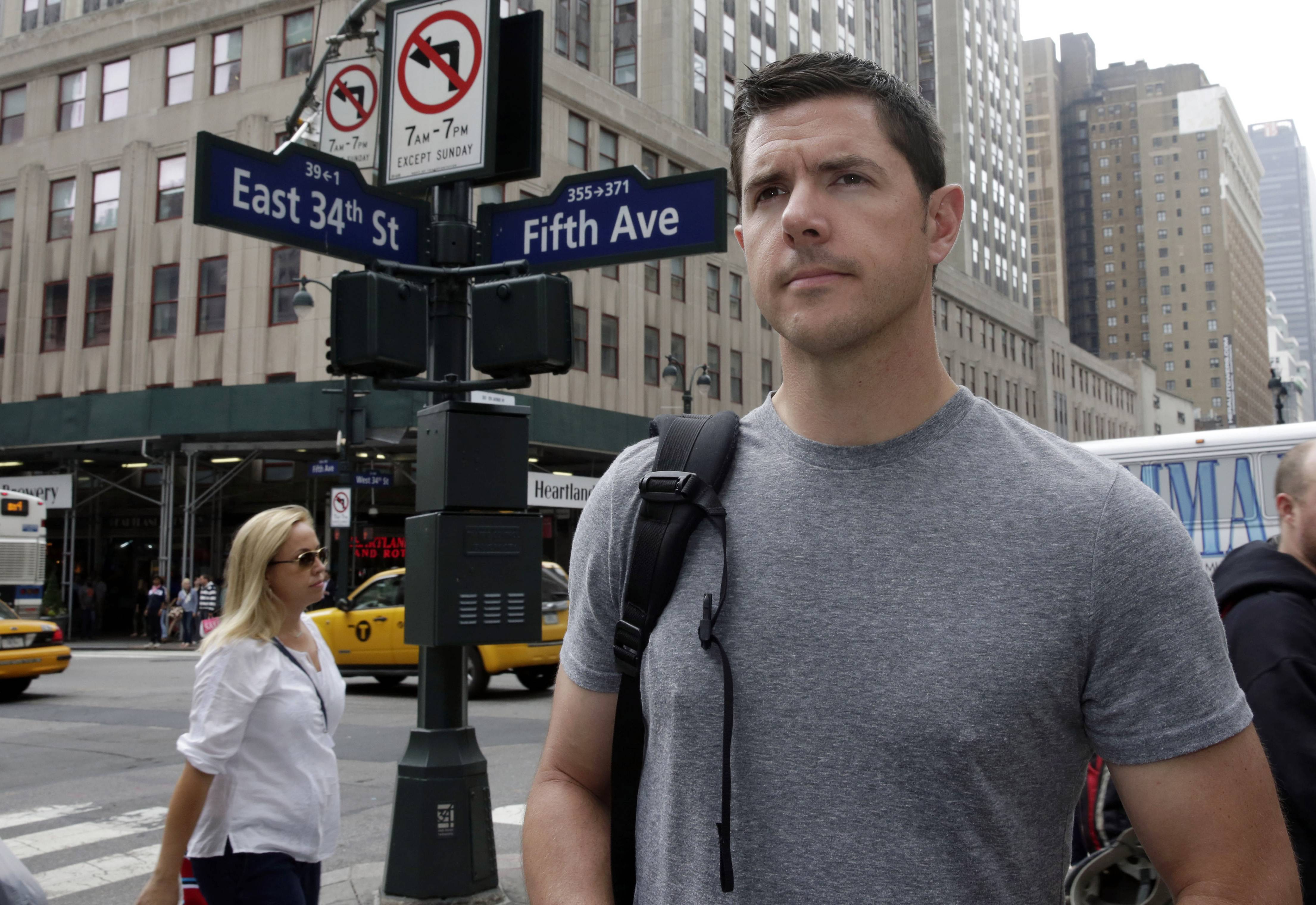 Former Army Sgt. Matthew Pelak stops Thursday along New York's Fifth Avenue. T