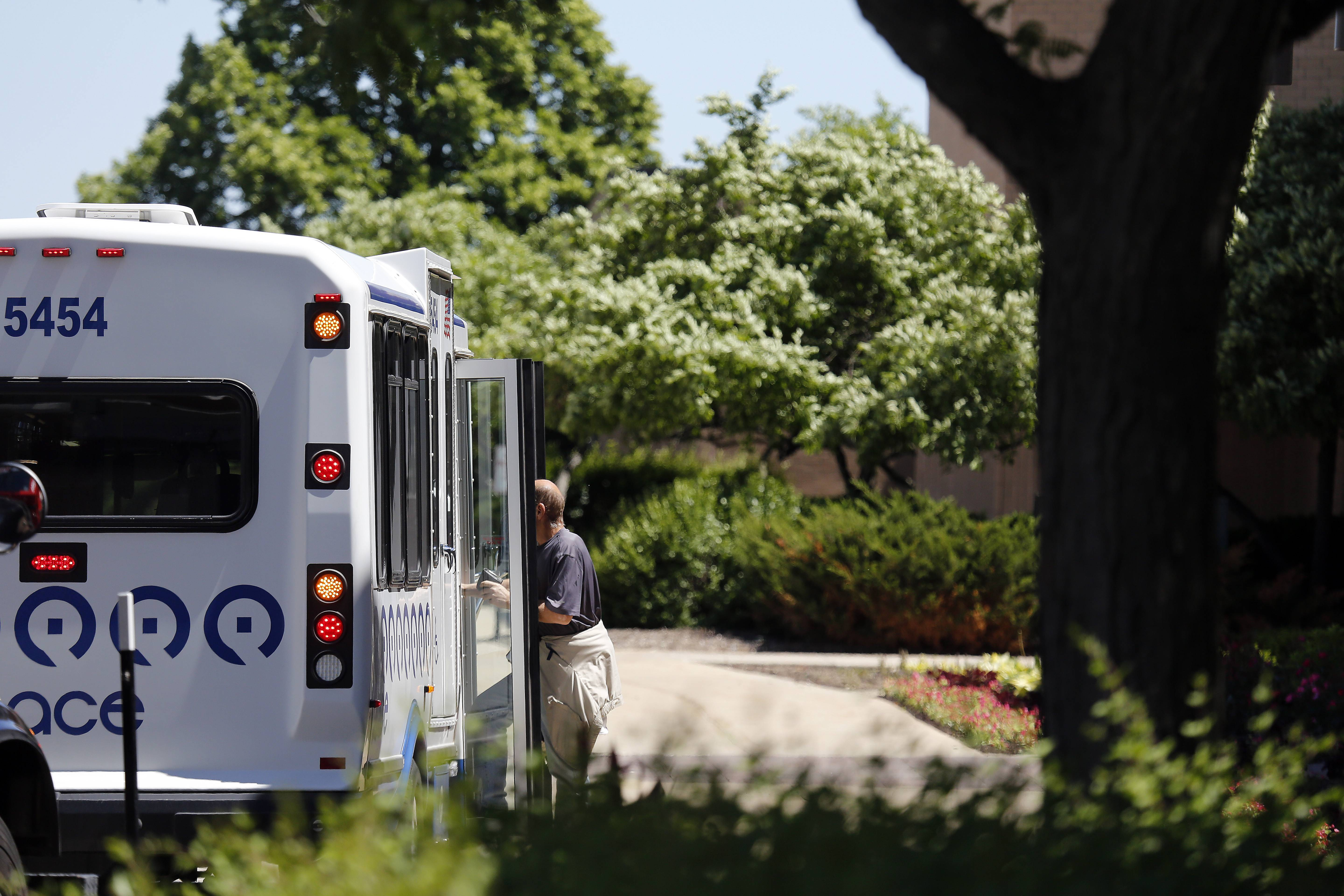 An unidentified man boards a Dial-a-Ride Pace bus Friday at Spring Hill Mall in West Dundee. Huntley village officials are considering joining McHenry County's MCRide bus service, which would be available to all residents. Huntley started a temporary taxi service for Sun City seniors last winter because Grafton Township cut off its bus service. The MCRide service would cost Huntley $48,500 yearly and would enable all residents to commute within Huntley and around the county. Village officials want neighboring taxing bodies, such as Grafton and Rutland townships and the Sun City Huntley Community Association to pitch in to cover the cost for the service.