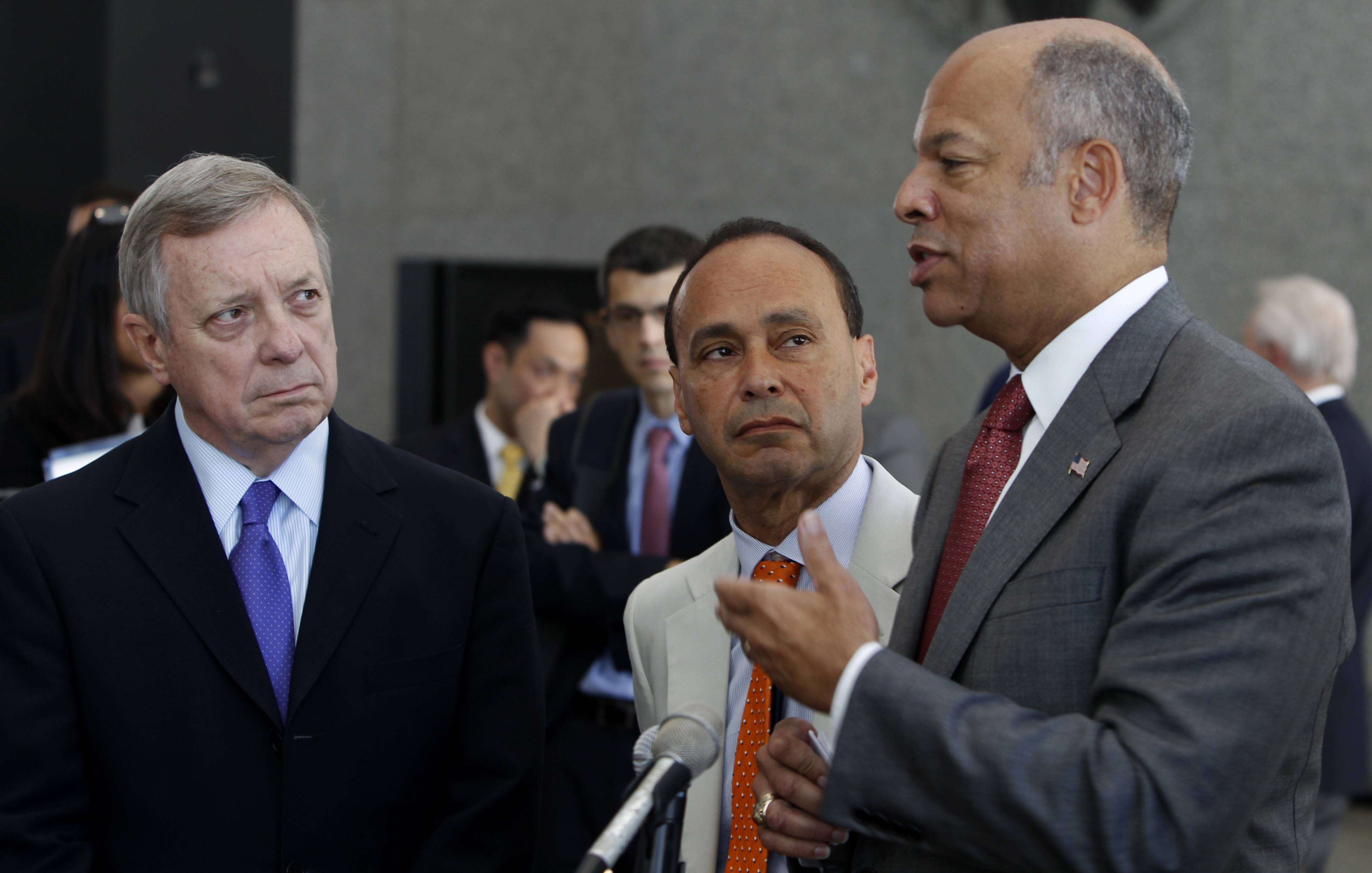 Sen. Dick Durbin and Rep. Luis Gutierrez listen as Secretary of Homeland Security Jeh Johnson speaks during a news conference regarding federal policy on deportations Friday in Chicago.