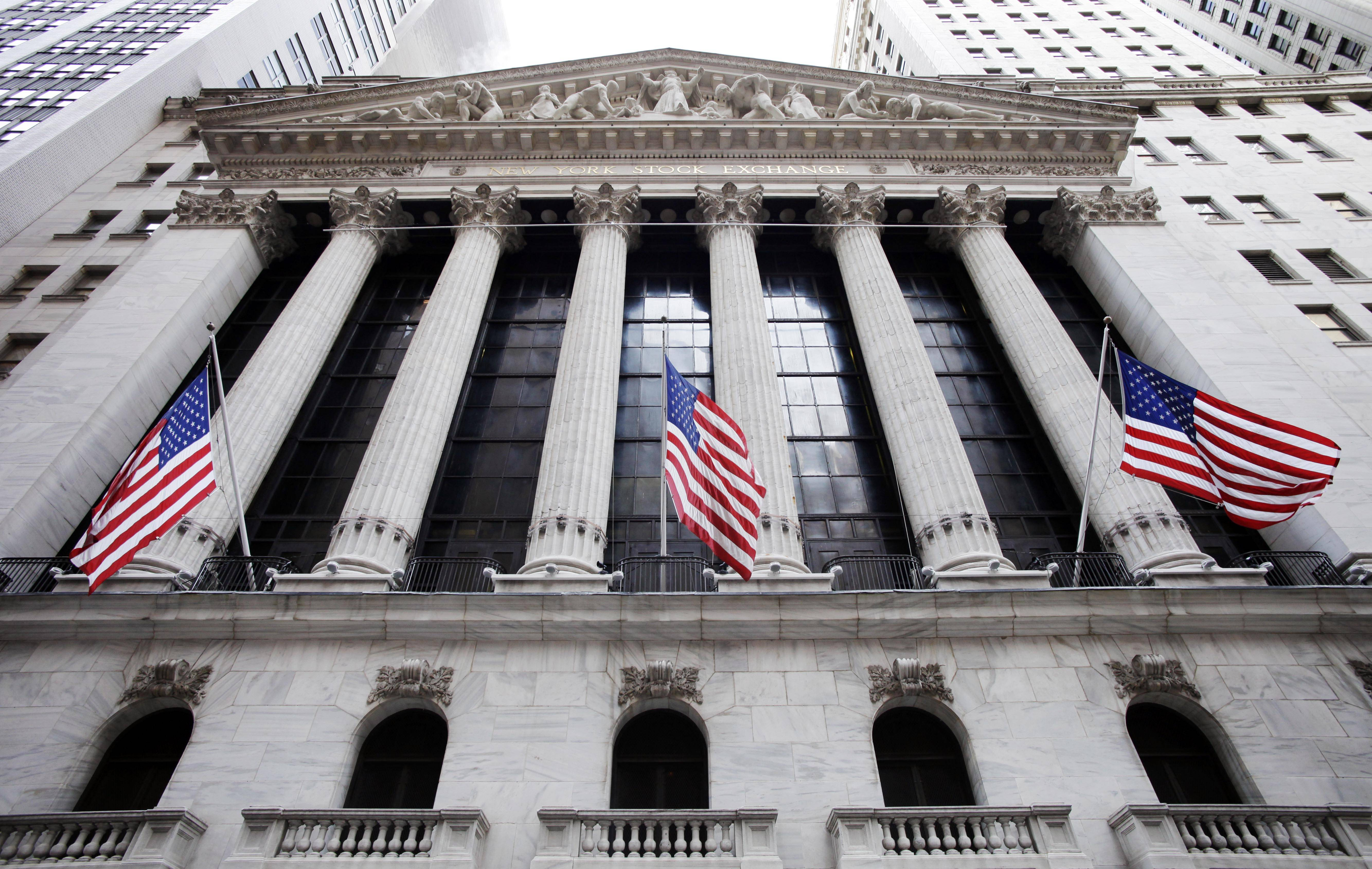 American flags fly in front of the New York Stock Exchange, in New York.