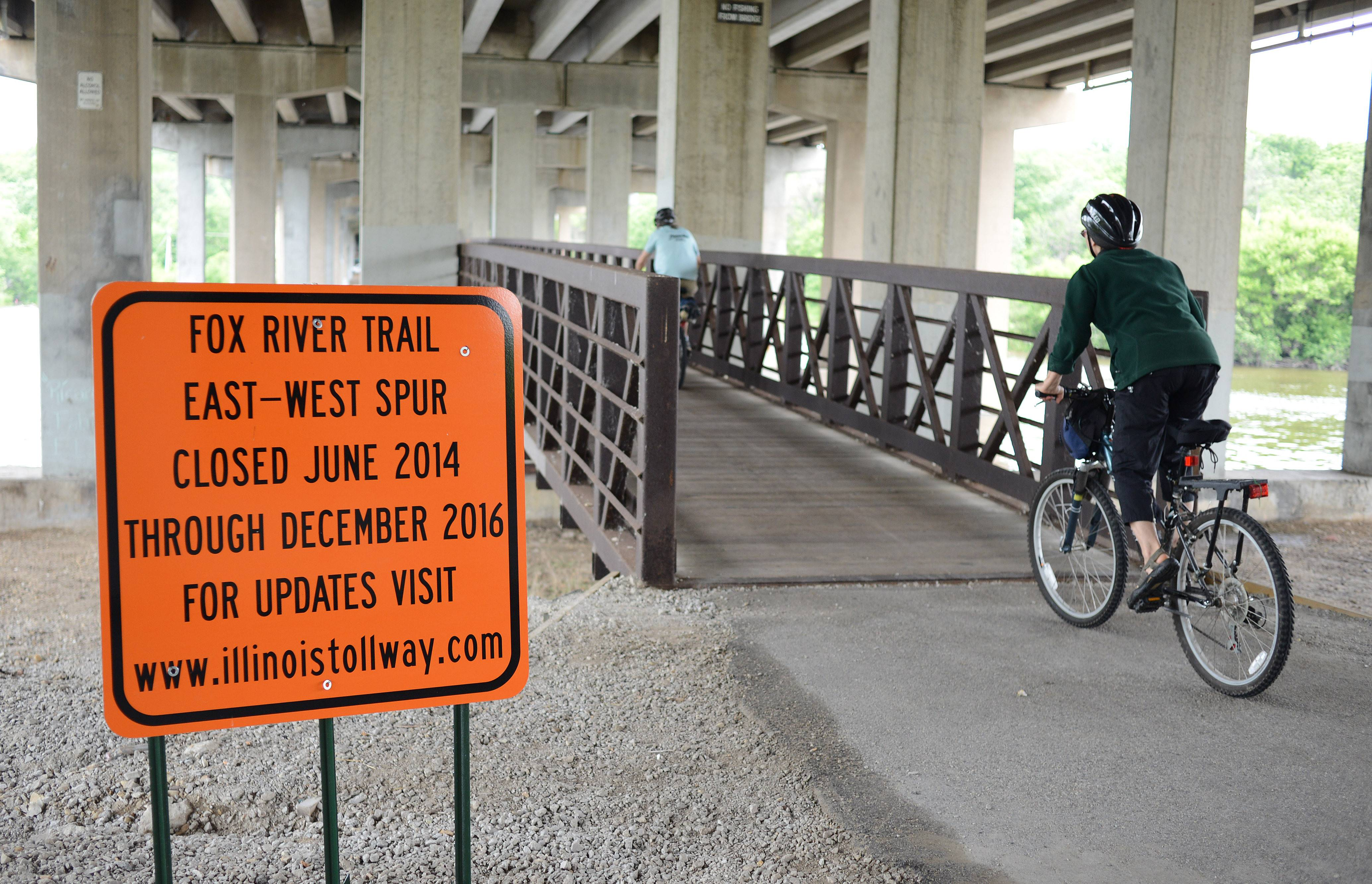 The bike and pedestrian bridge under the Jane Addams Memorial Tollway over the Fox River in Elgin will be disassembled soon. A new one will open in late 2016, officials said.
