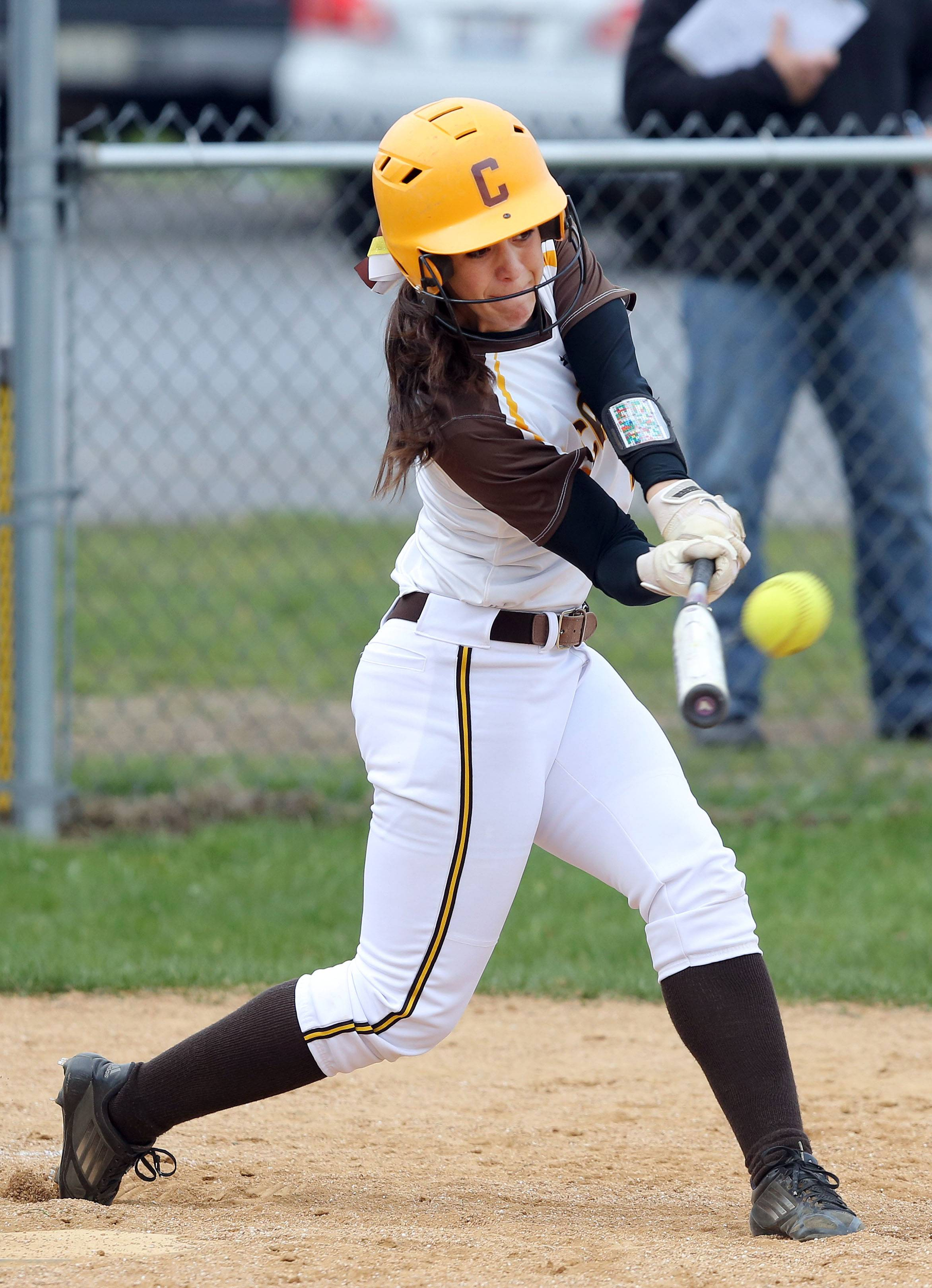 Carmel's Kathleen Felicelli connects for a 3-run homer against Nazareth during action this spring.