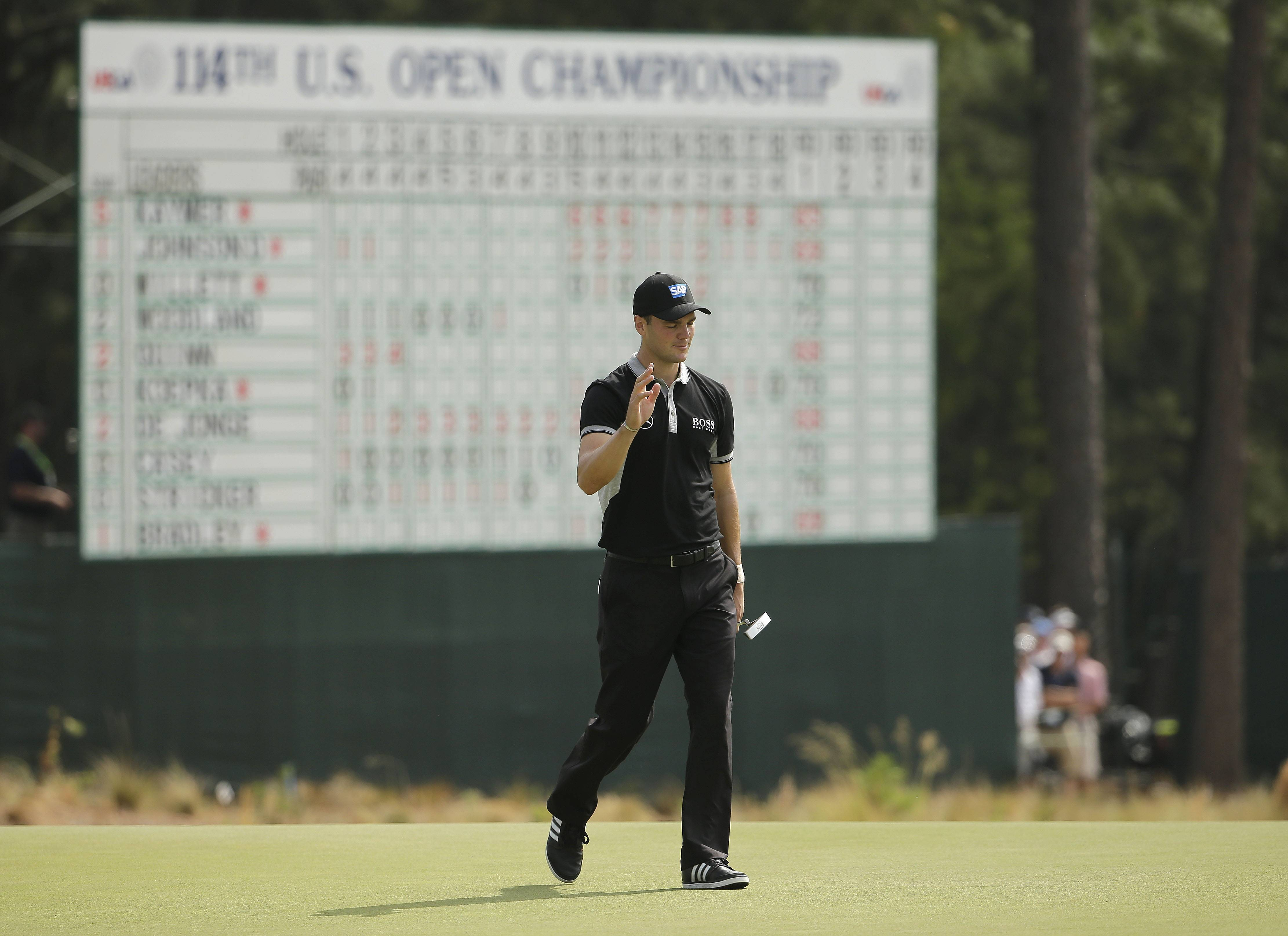 Martin Kaymer set the 36-hole scoring record at the U.S. Open on Friday with another 5-under 65 — this one without a single bogey — to build an early eight-shot lead and leave the rest of the field wondering if the 29-year-old German was playing a different course, or even a different tournament.