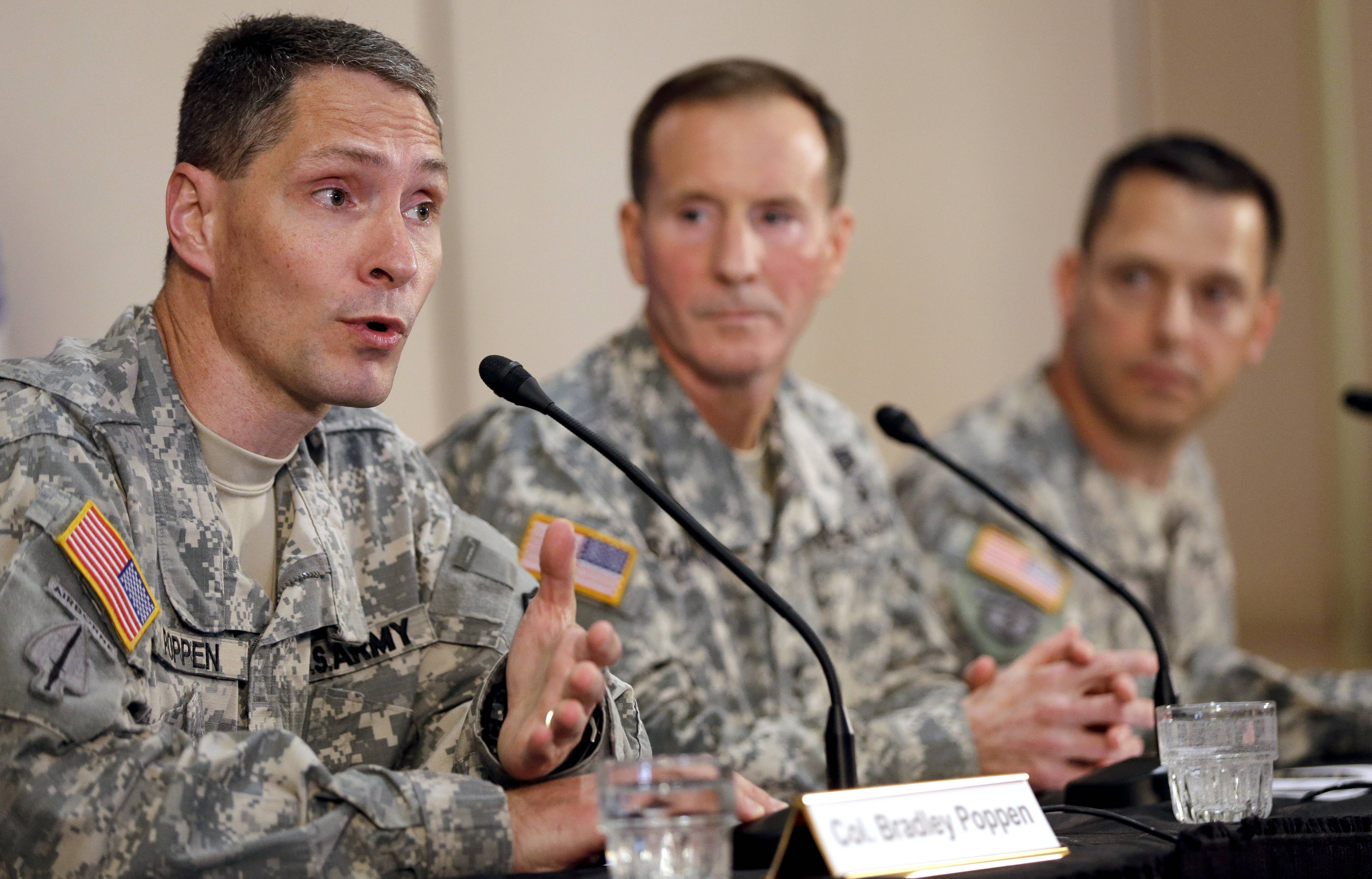 Col. Bradley Poppen, left, answers a question Friday during a news conference regarding Sgt. Bowe Bergdahl in San Antonio, Texas. Bergdahl, the Army sergeant who has been recovering in Germany after five years as a Taliban captive, returned to the United States early Friday to continue his medical treatment at Brooke Army Medical Center. Joining Poppen are U.S. Army South Commander Maj. Gen. Joseph P. DiSalvo, center, and Col. Ronald Wool.
