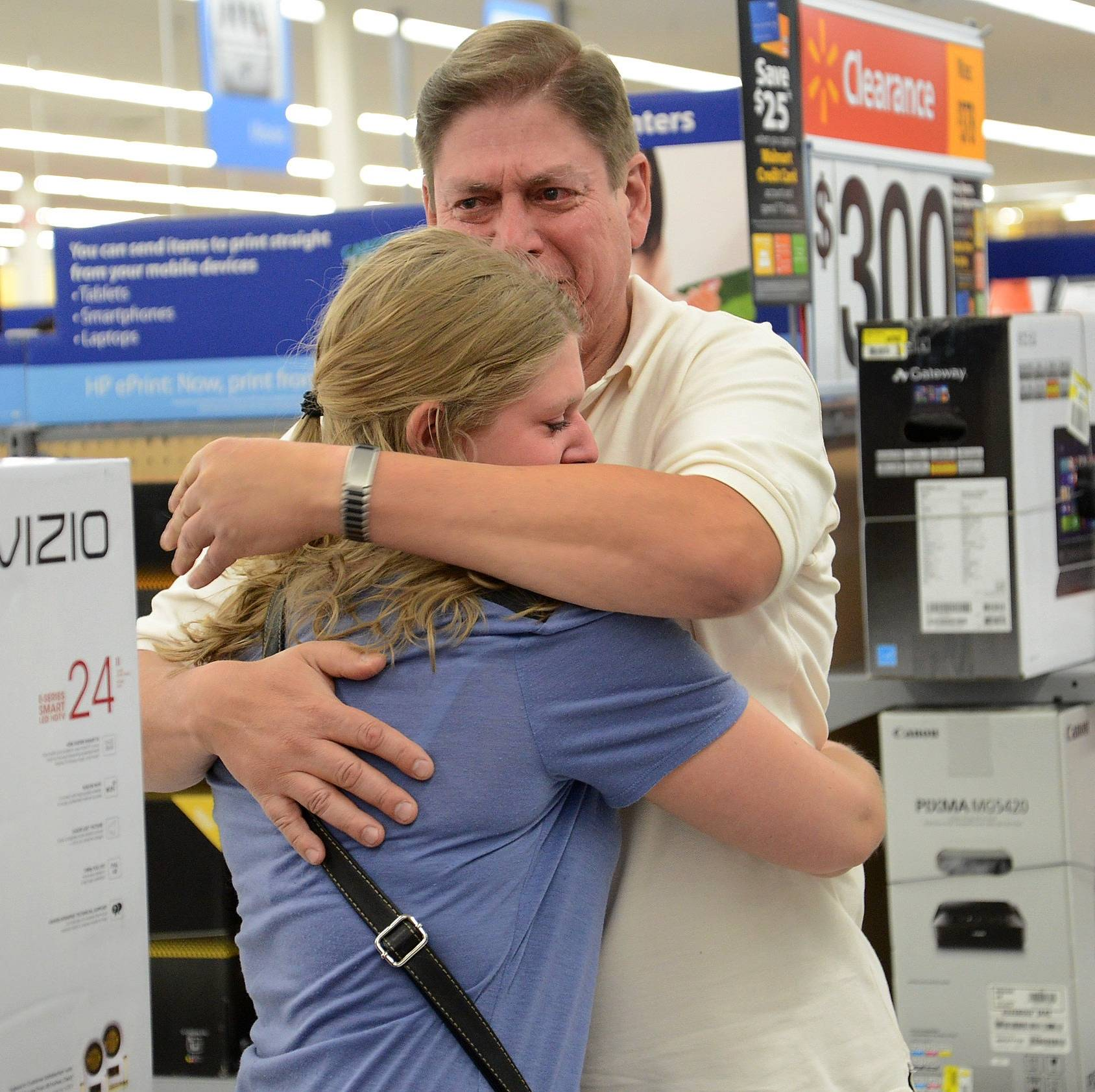 Michael Perrella of Wheeling is surprised at the Wheeling Wal-Mart after his daughter Nicole's entry won him a national contest sponsored by Vizio.