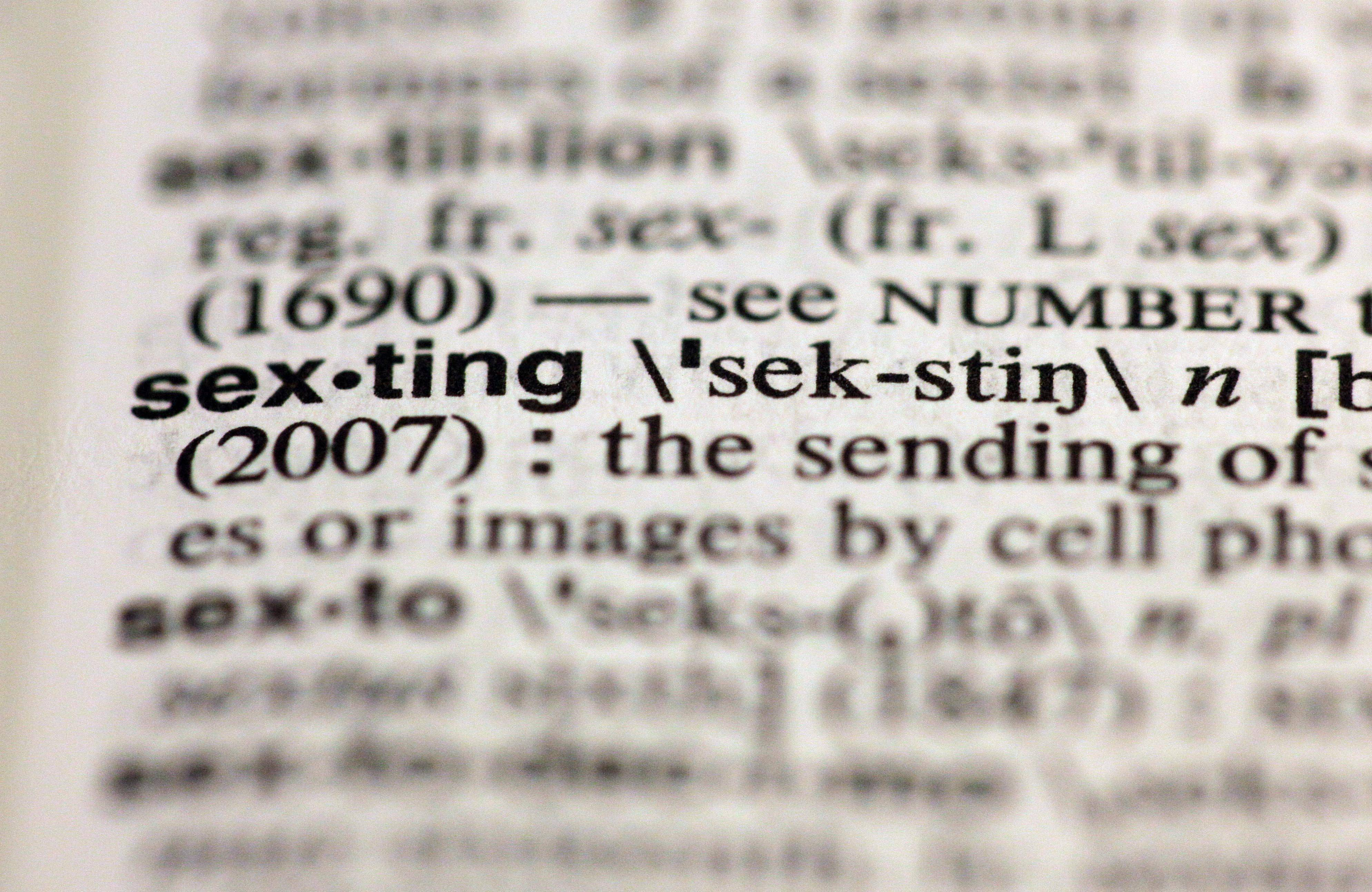"The entry ""sexting,"" photographed in New York, Friday, Aug. 10, 2012, is one of the 15 new additions in the 11th edition of Merriam-Webster's Collegiate Dictionary."